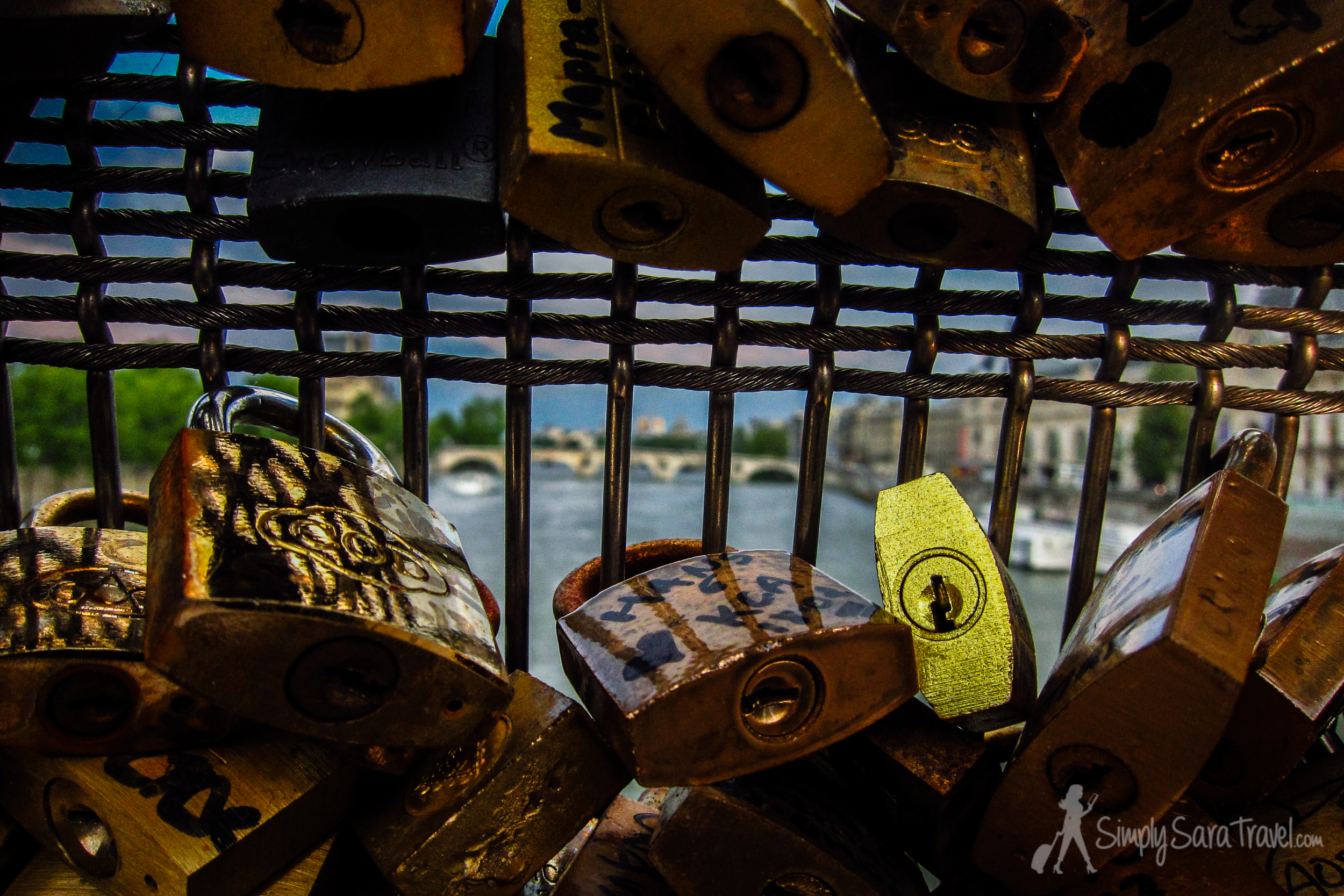 Couples proclaim their love with these locks over the Seine
