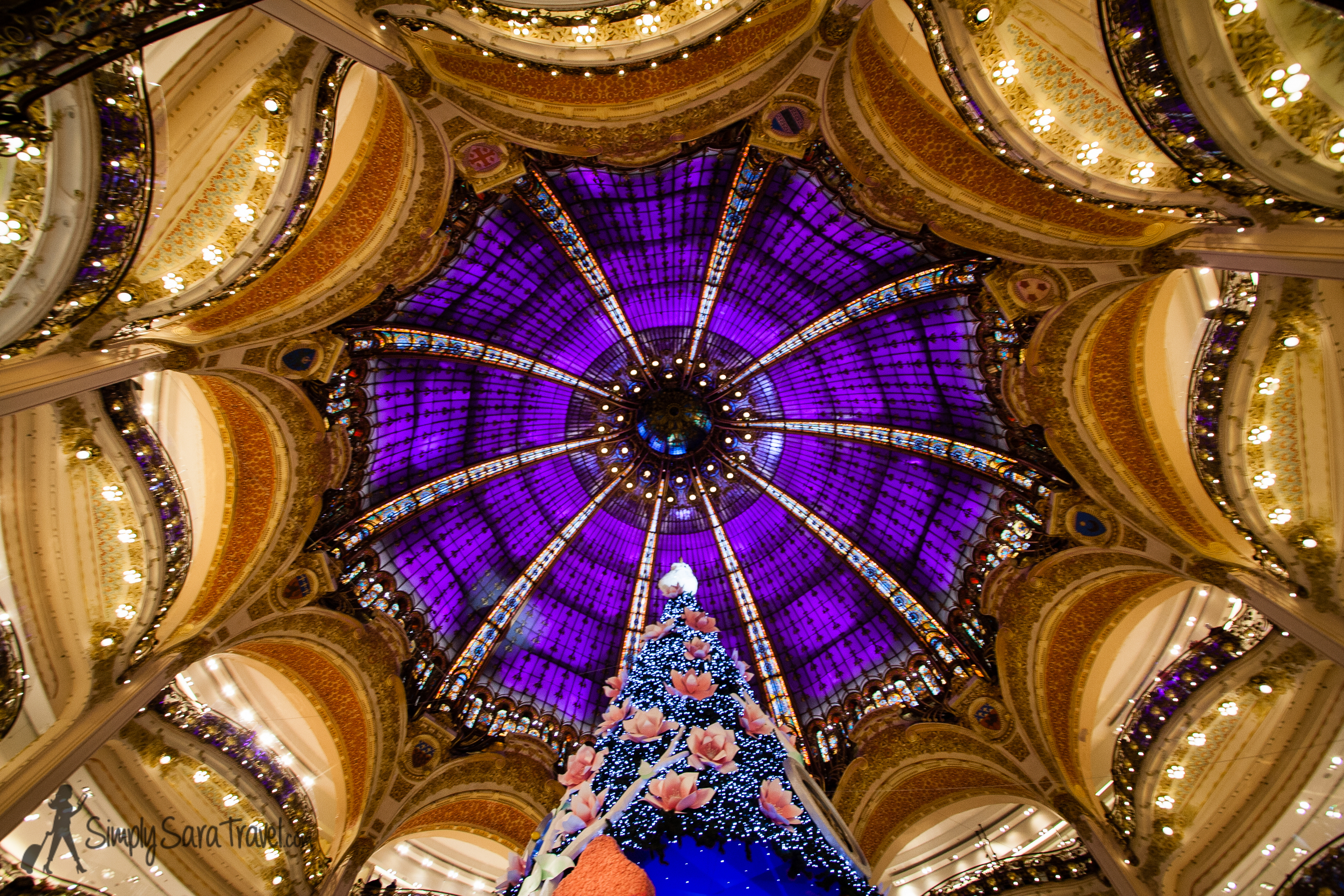 The  65-foot tall Christmas tree  in the middle of Galaries Lafayette
