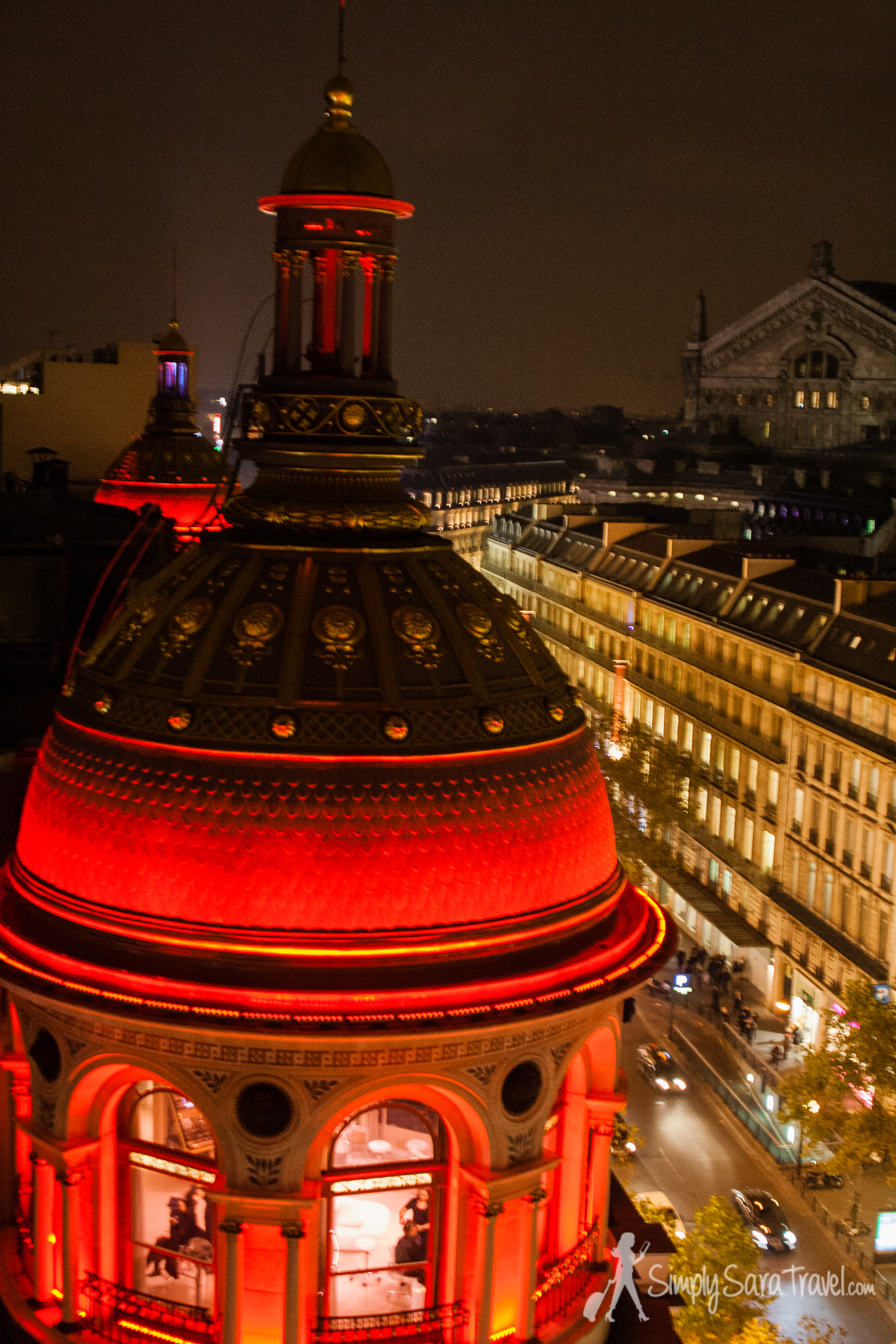 The top of Printemps with Palais Garnier (the opera) in the background