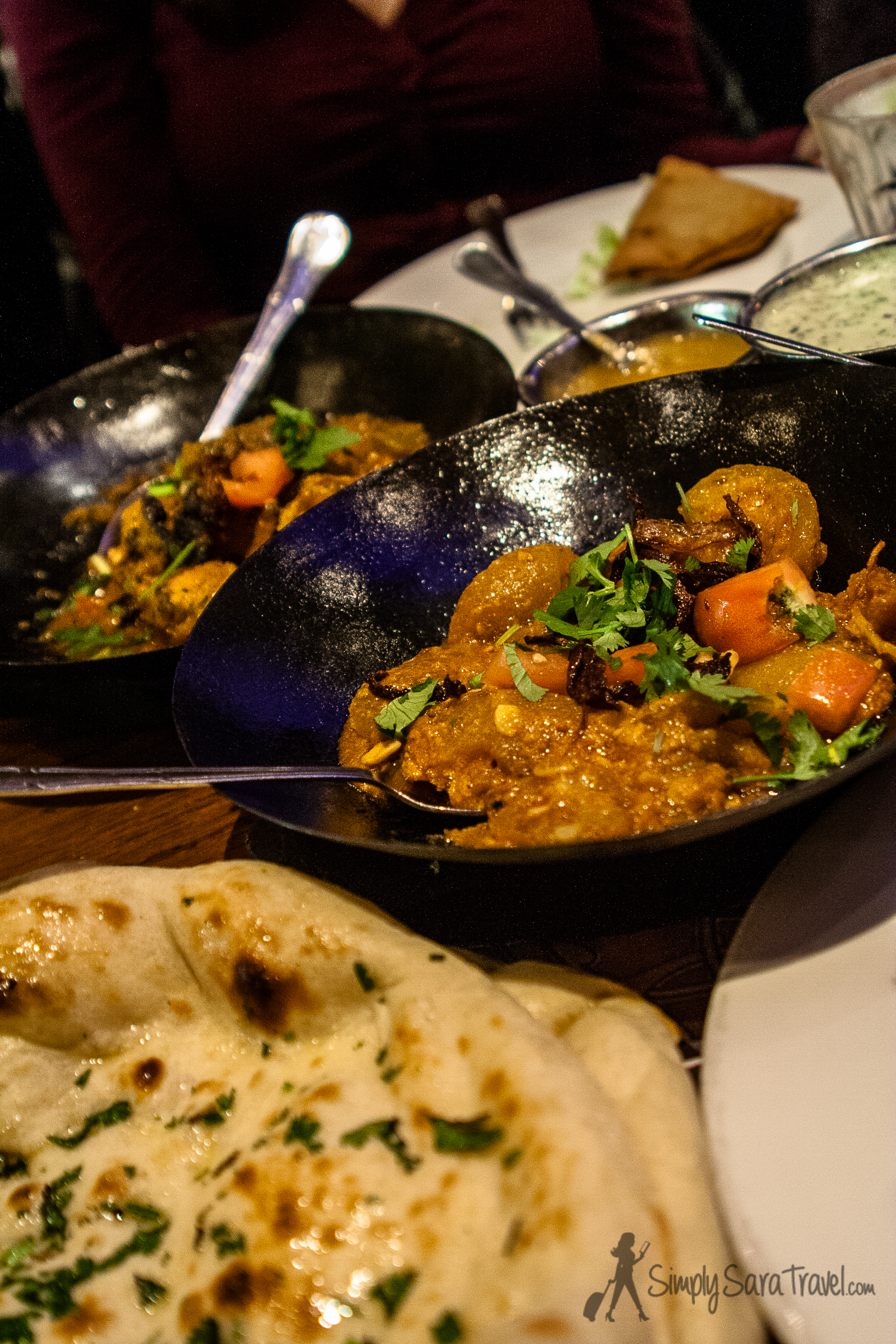 ChickenTikka Masala and Tinda Masala (pumpkin dish) alongside some of the best naan I've eaten