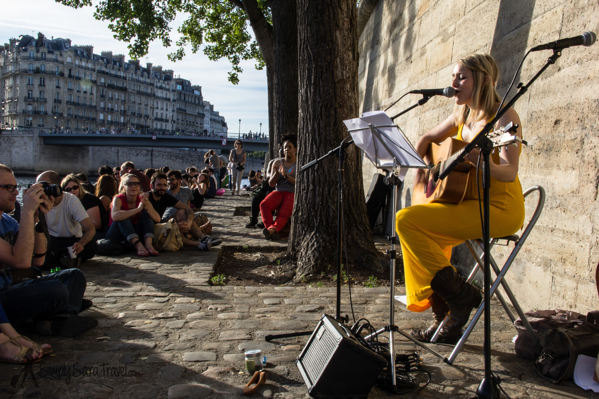 Watching  Devon Graves  perform on the banks of the Seine