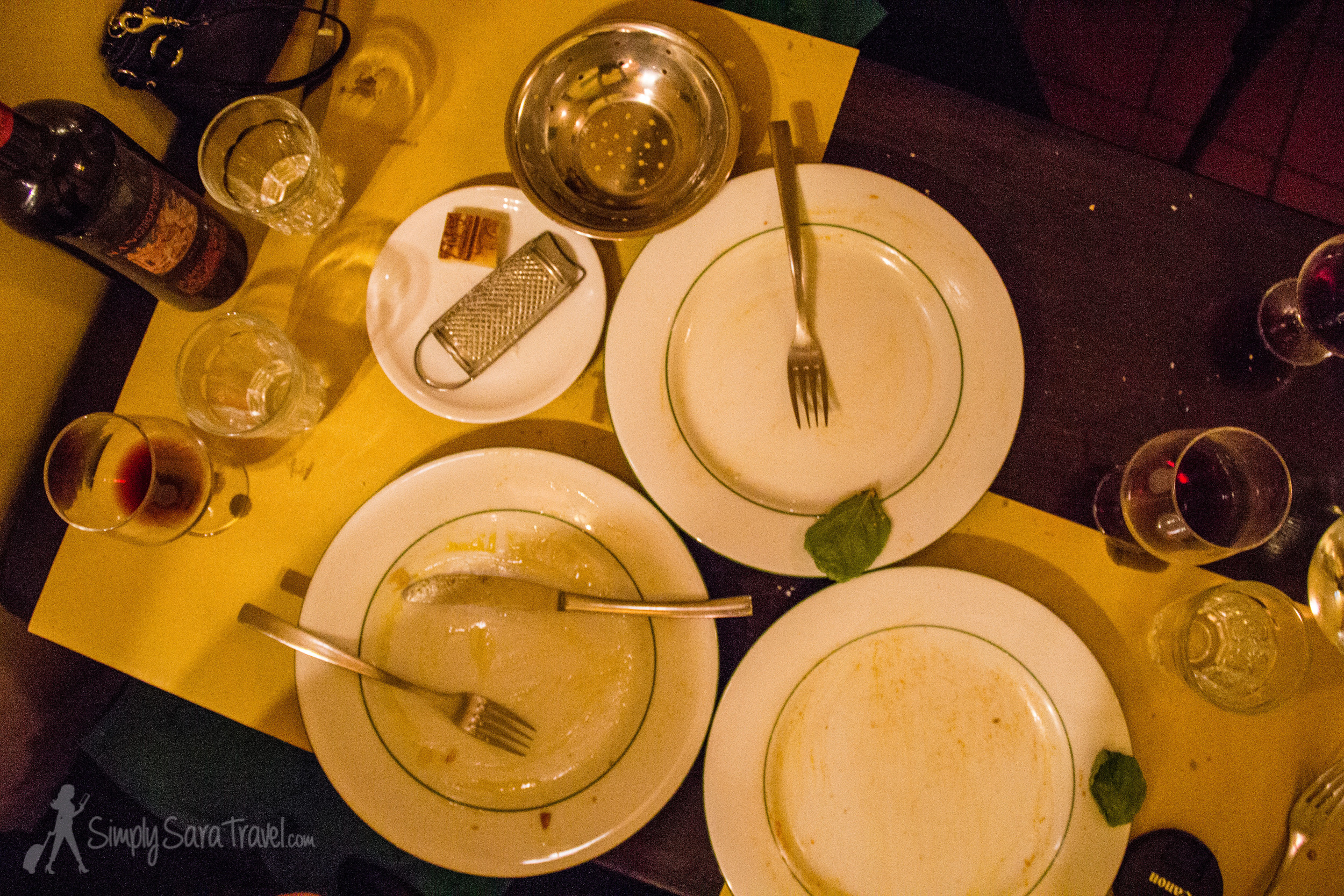 No one leaves without clearing their plate here! (Also note the small piece of Parmesan cheese and personal grater every table gets.)
