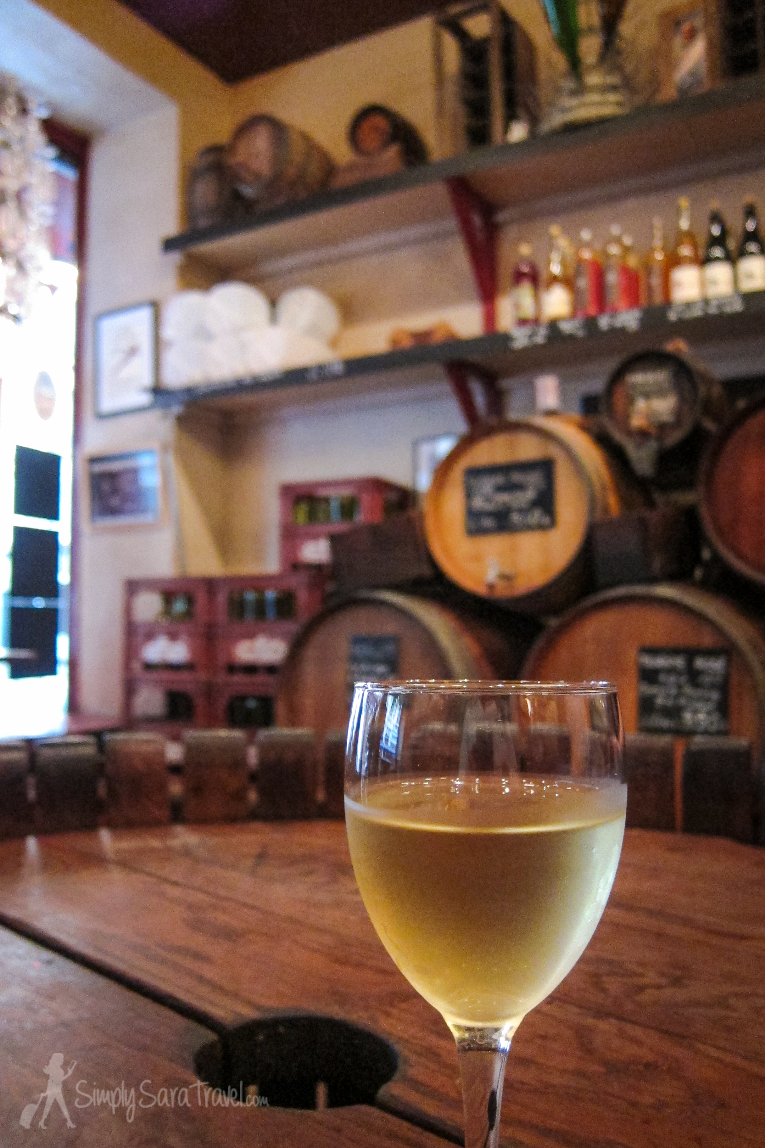 See those barrels of wine in the background? Locals stop by to purchase wine by the liter straight from the barrel!