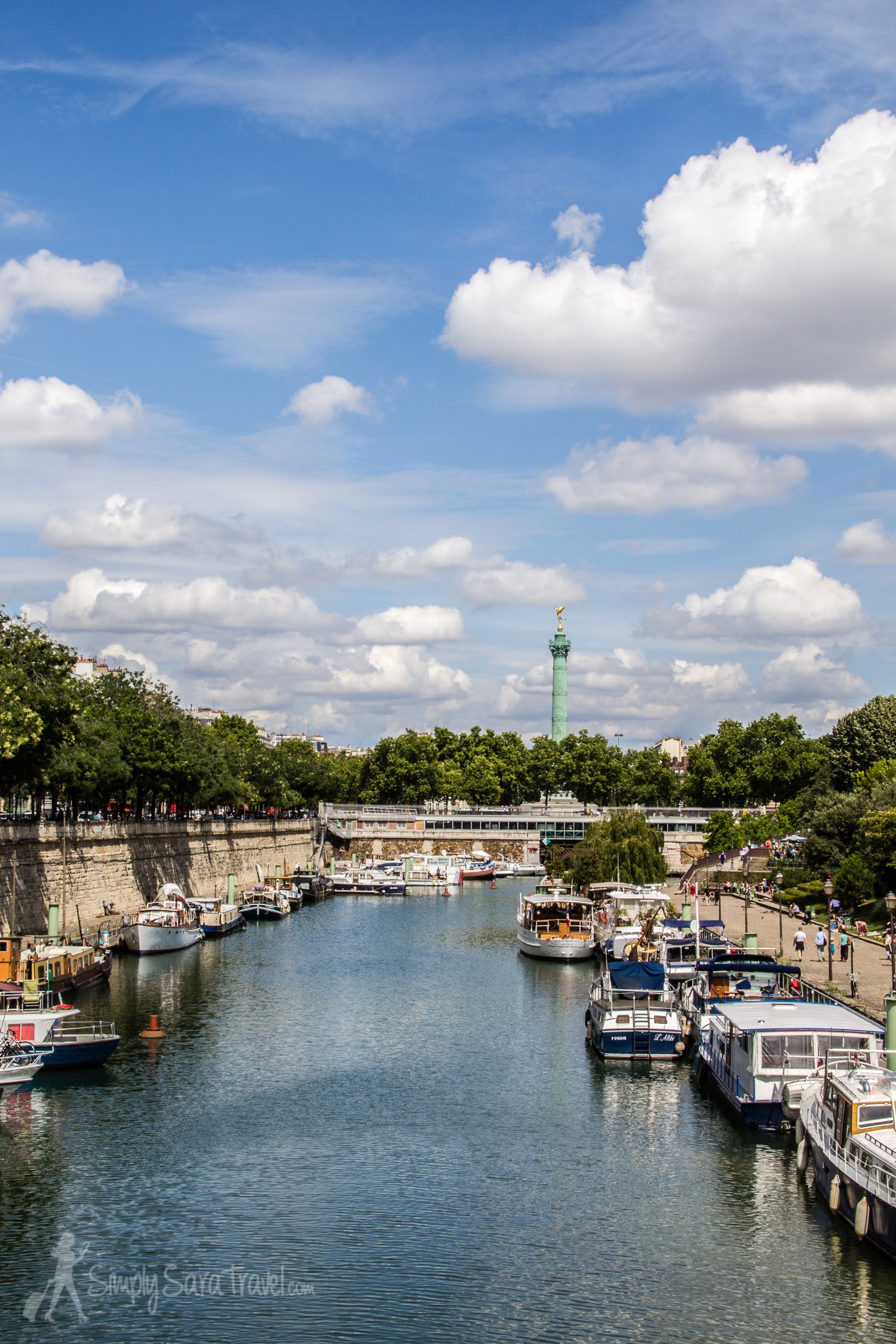 Boats at Port de l'Arsenal with a view of Bastille