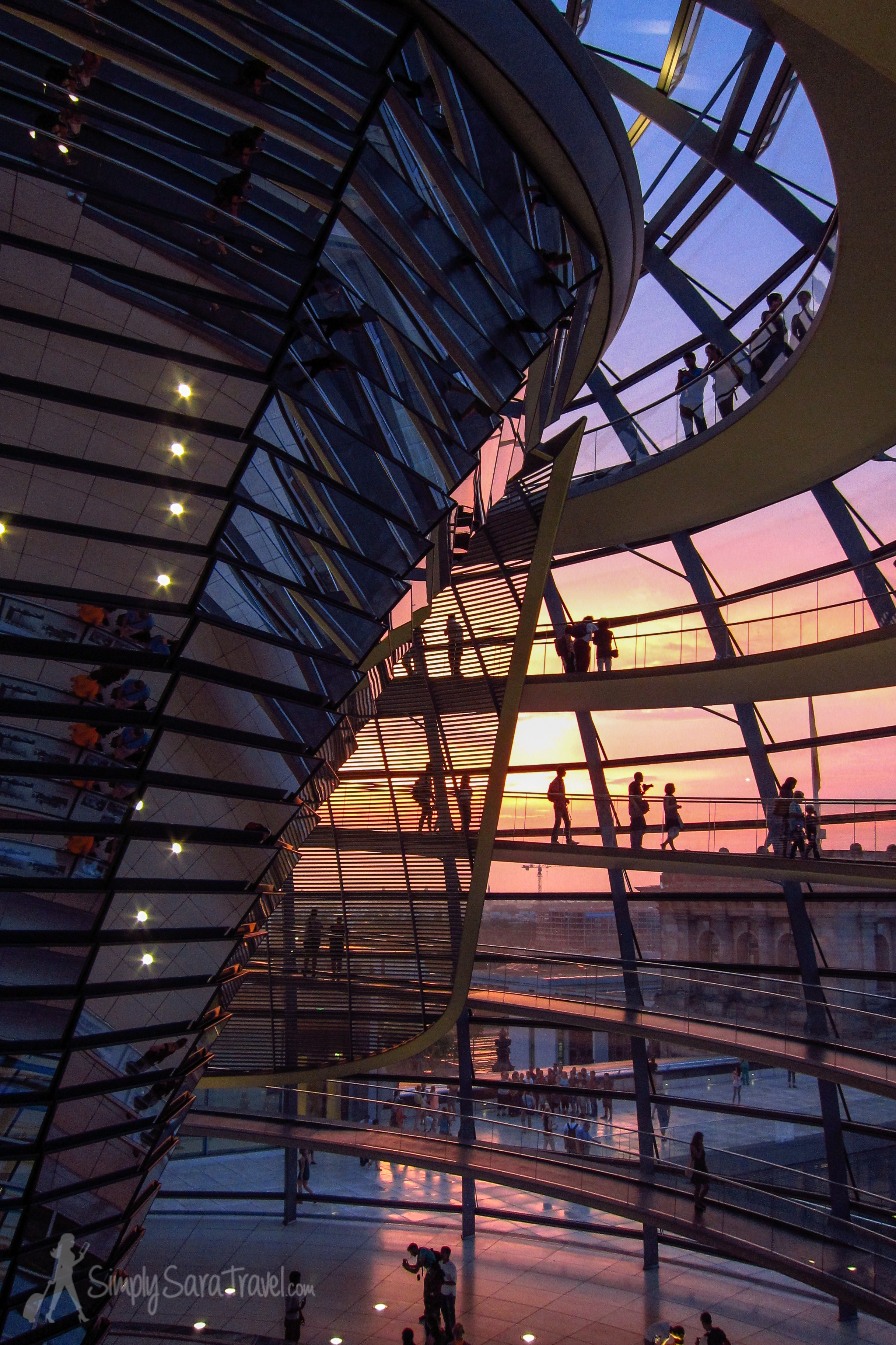 Sunset lights up the Reichstag's glass dome, Berlin