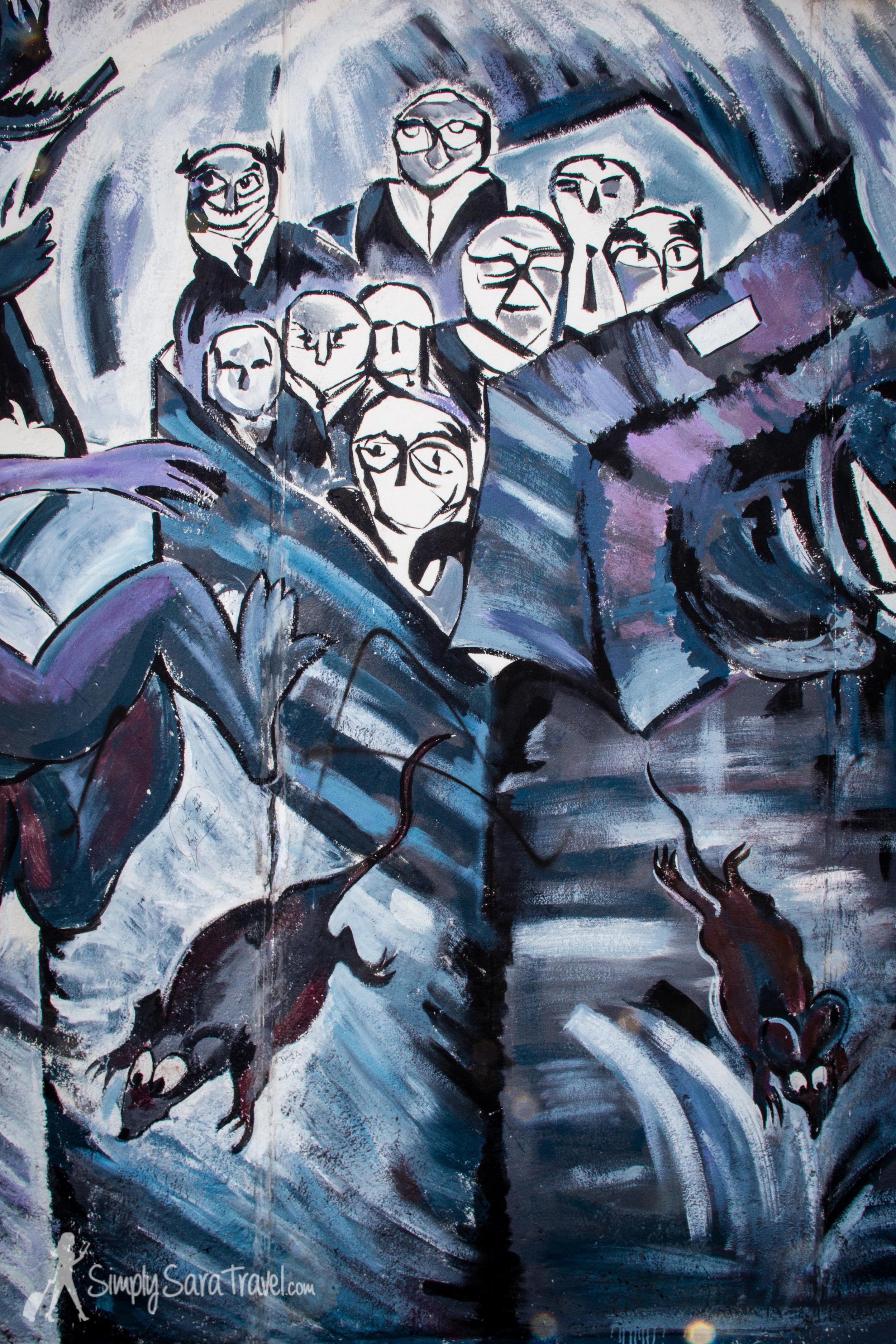 Dark painting at East Side Gallery, Berlin, Germany