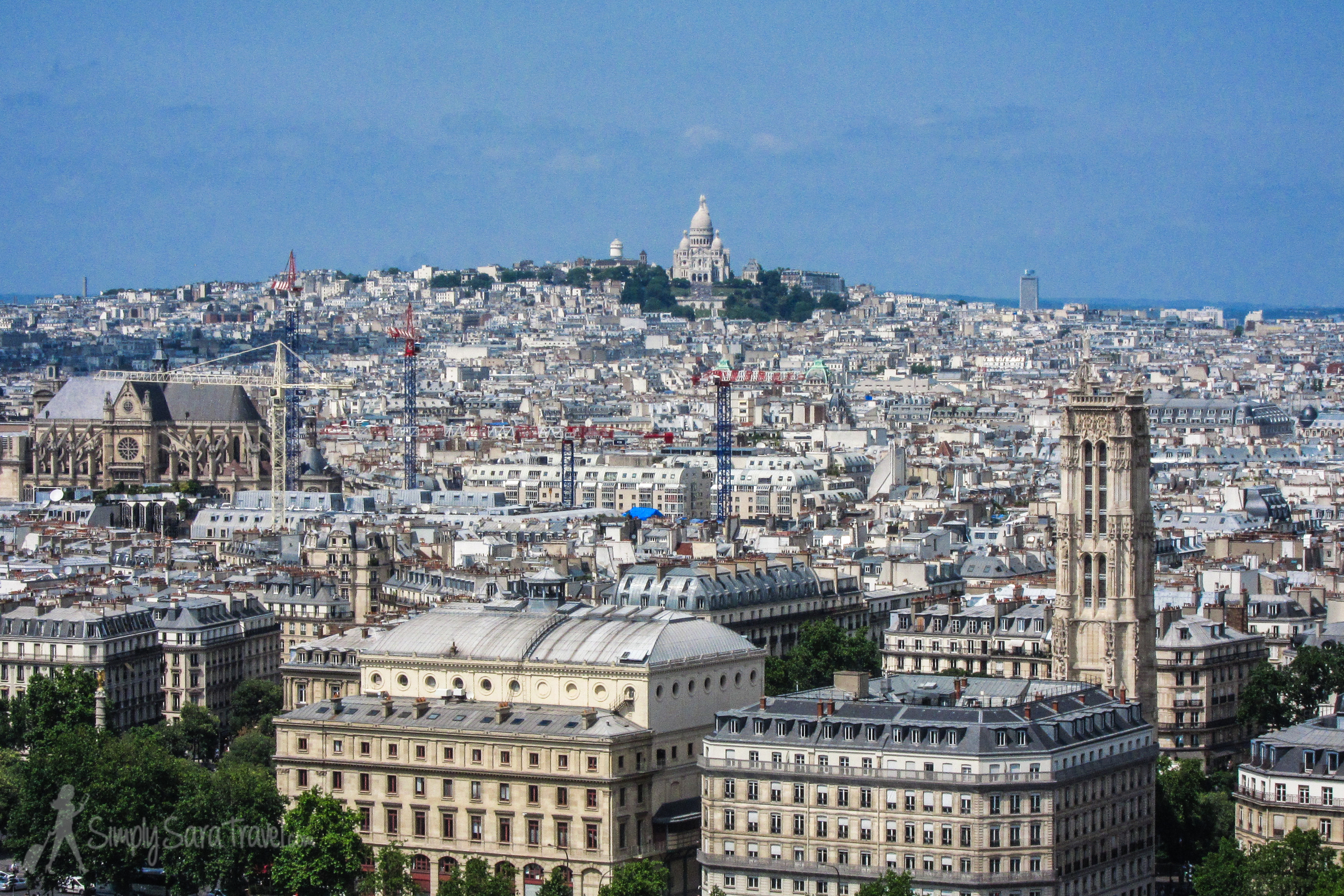 A view of Tour Saint-Jacques from the towers ofNotre-Dame Cathedral (andSacré-Cœur perched up on the hill)