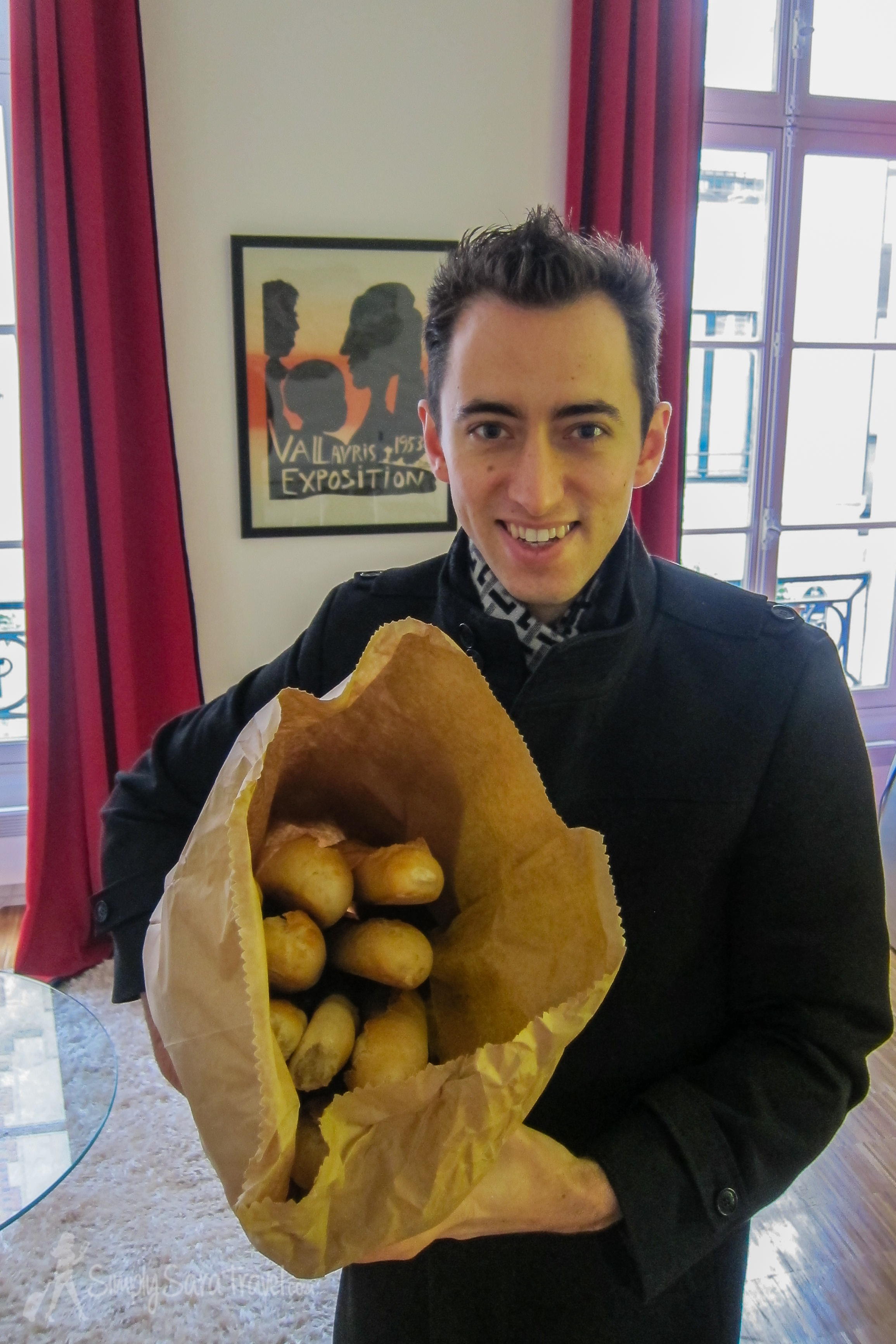 Michael may not cook but he has the important task of procuring the baguettes for the party. Here he is happily holding15 fresh out of the oven!