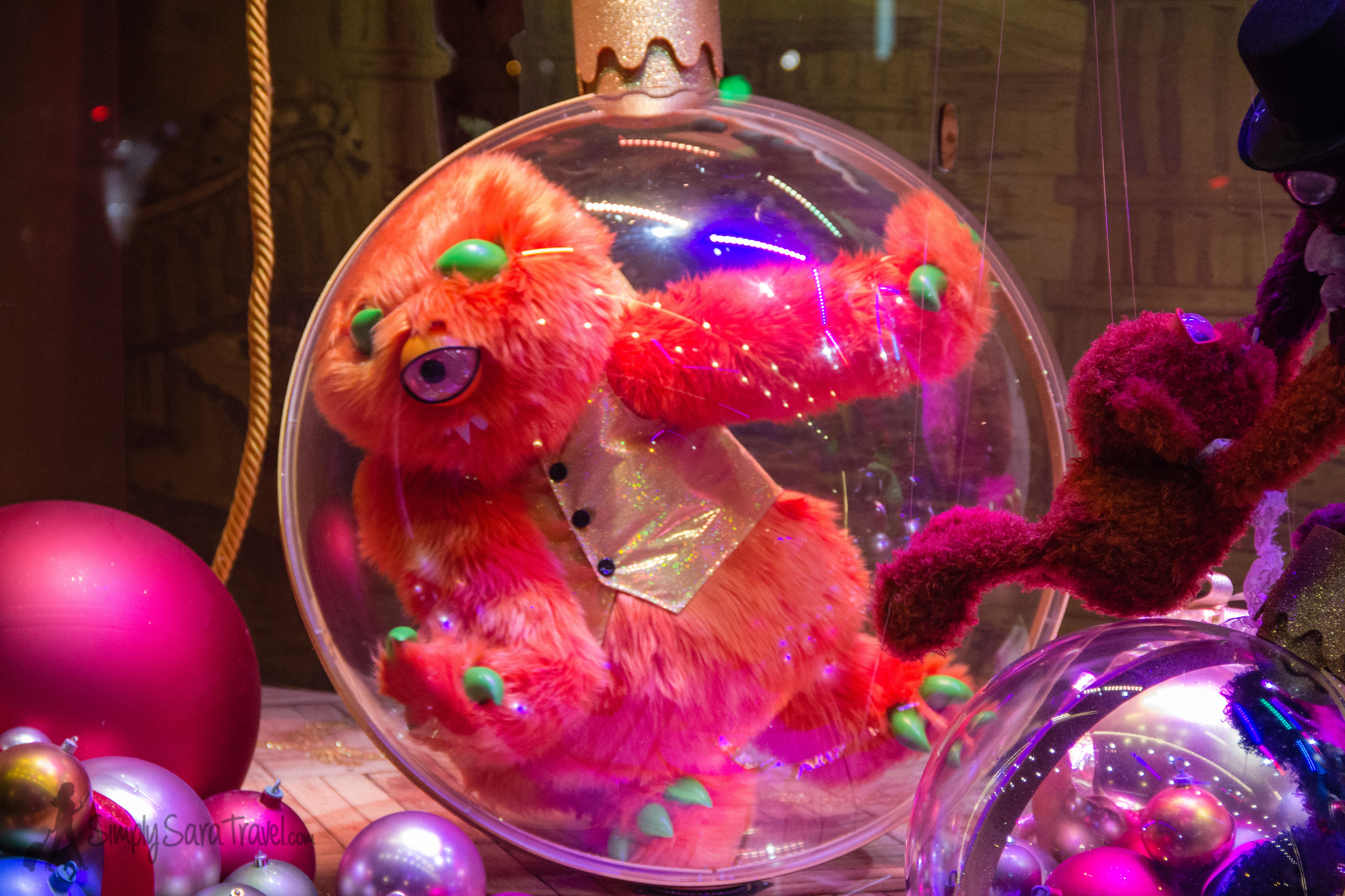 Monster trapped in ornament in Galeries Lafayette's Christmas window display in Paris
