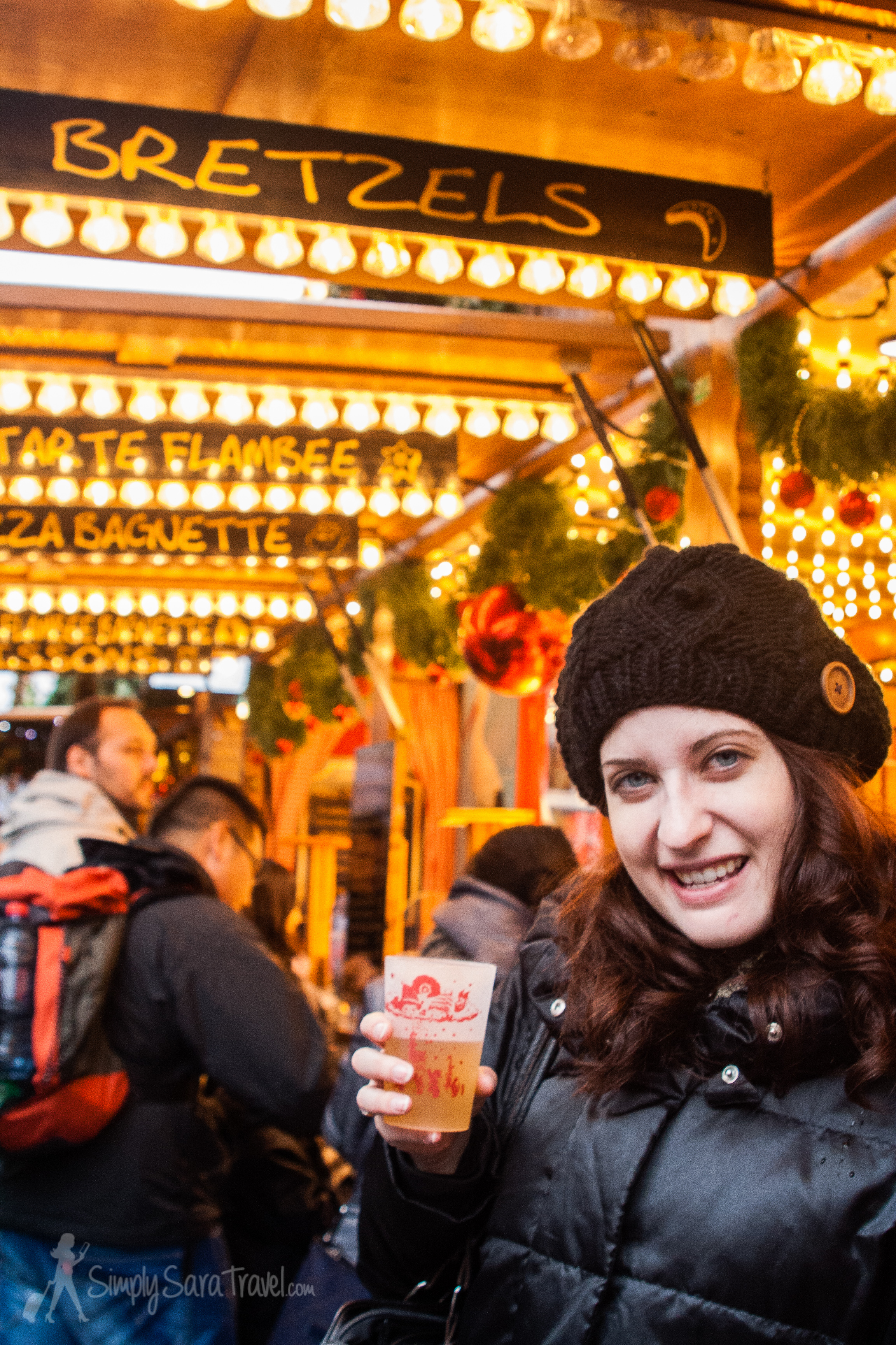 Bundle up with awinter coat and hat, and warm up with a glass of mulled wine!