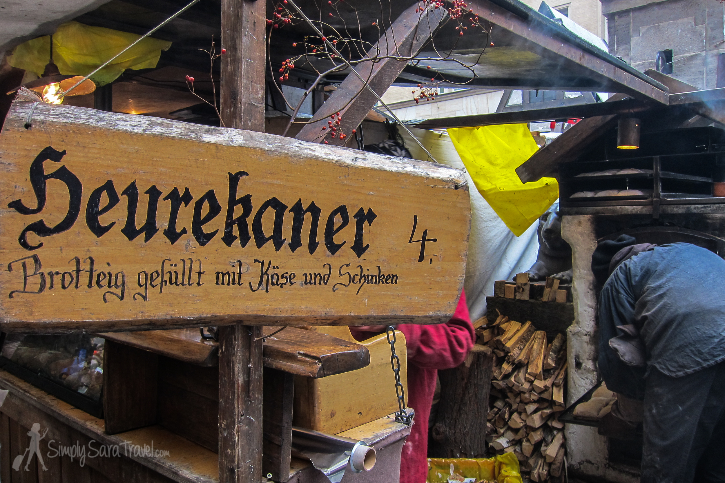 The stand sign says Heurekaner -bread dough filled with cheese and ham. What it doesn't convey is just how good this oven baked treat is.