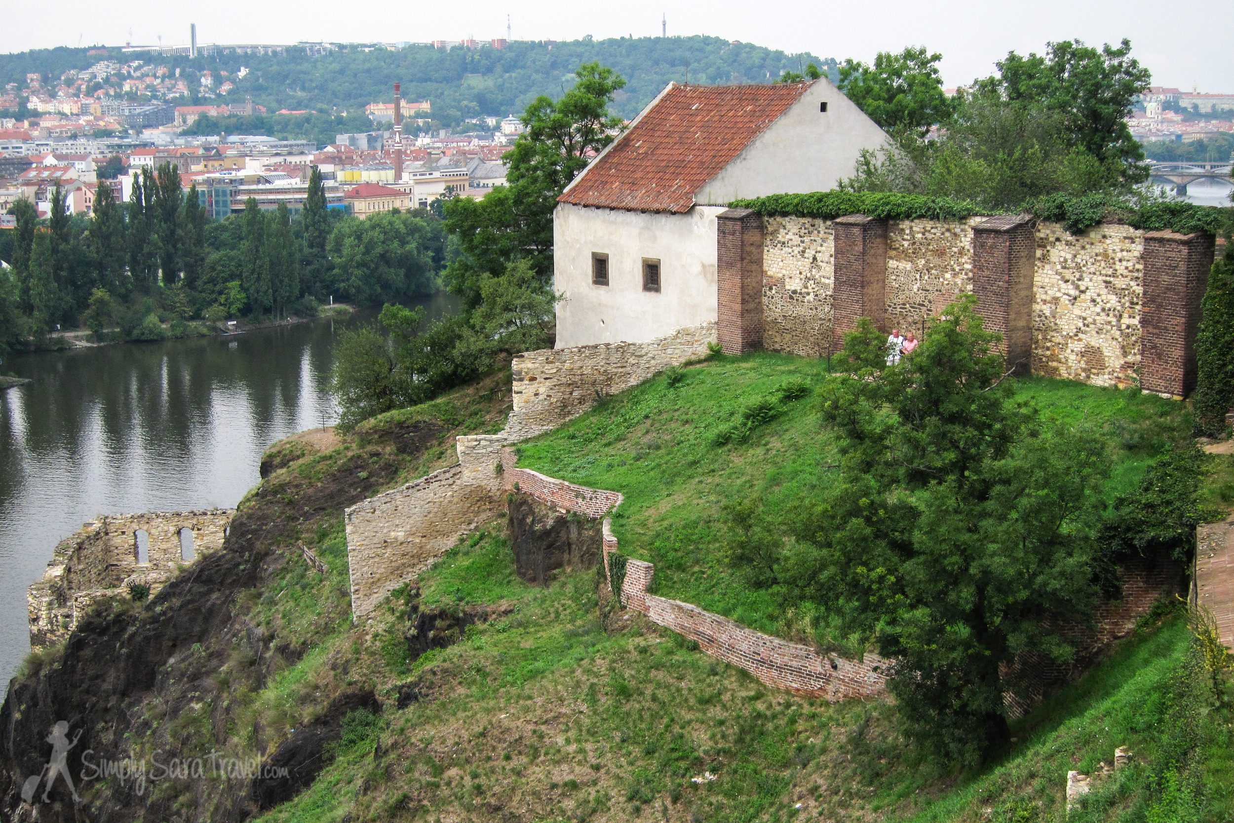 A lookout over the Vltava River from a spot nearby the Vyšehrad cemetery and the Church of Peter and Paul