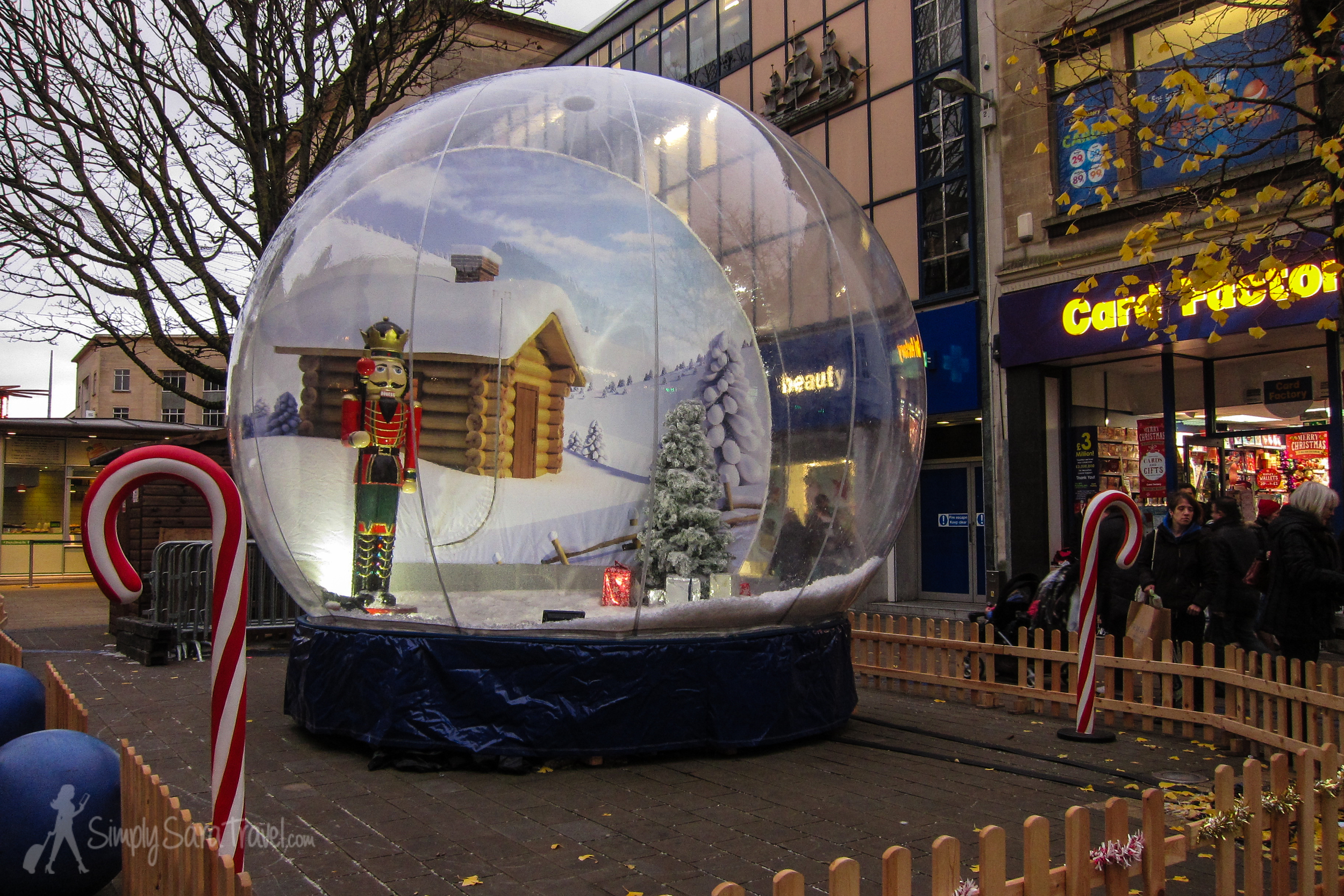"""This was a first for me - this life-size snow globe allows people to take a picture inside with a fan blowing the """"snow"""" around."""