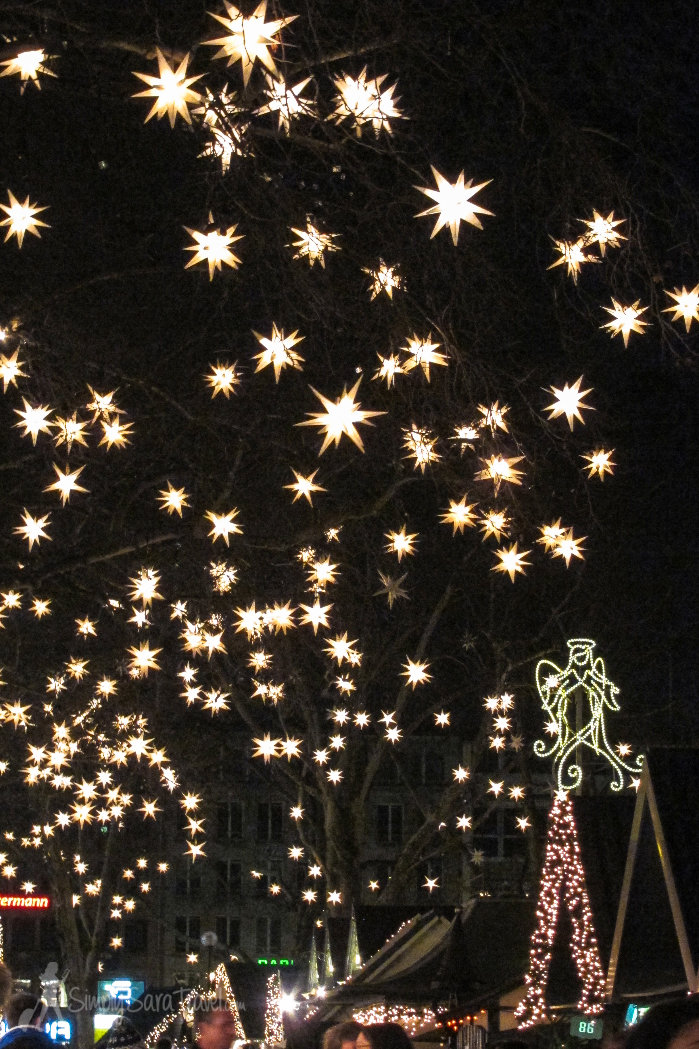 White stars and angels decorate the Markt der Engel in Cologne, Germany