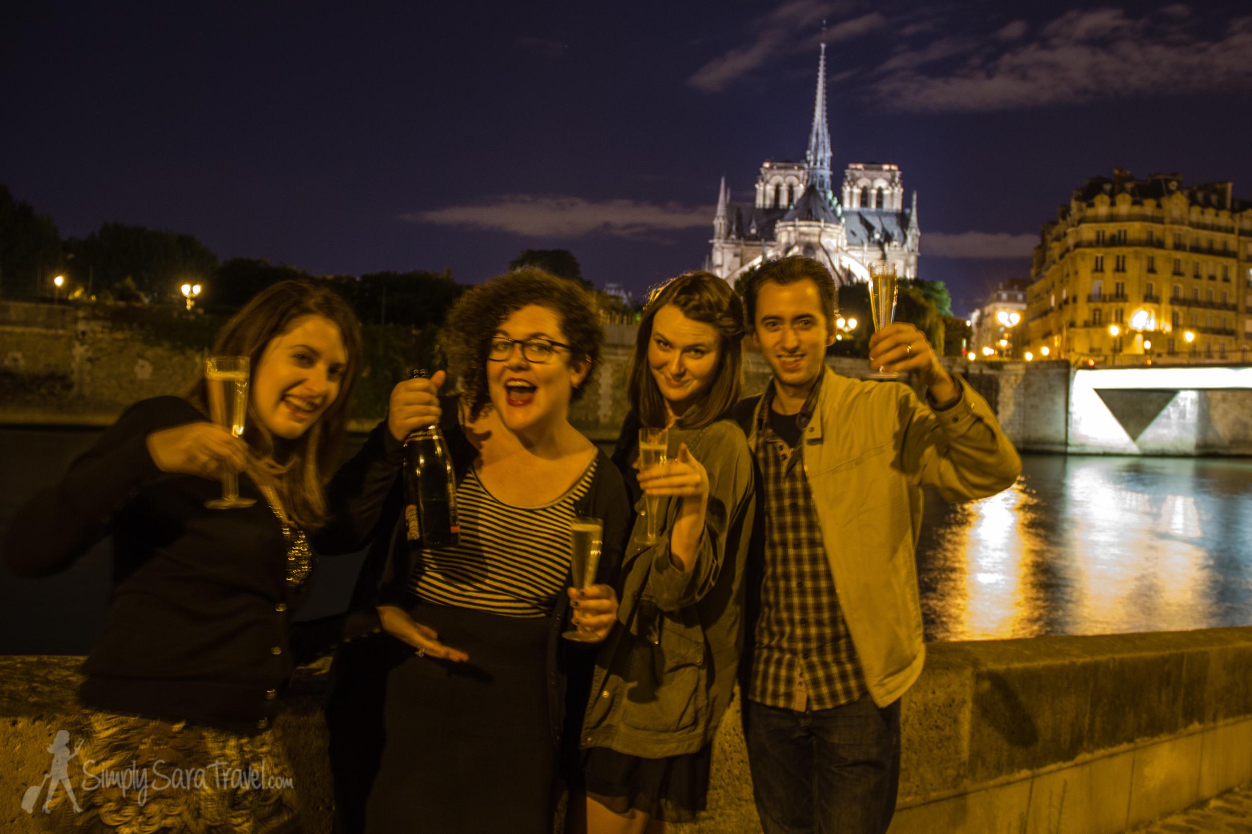 Cheers to friendship at our picnic spot onÎle Saint-Louis