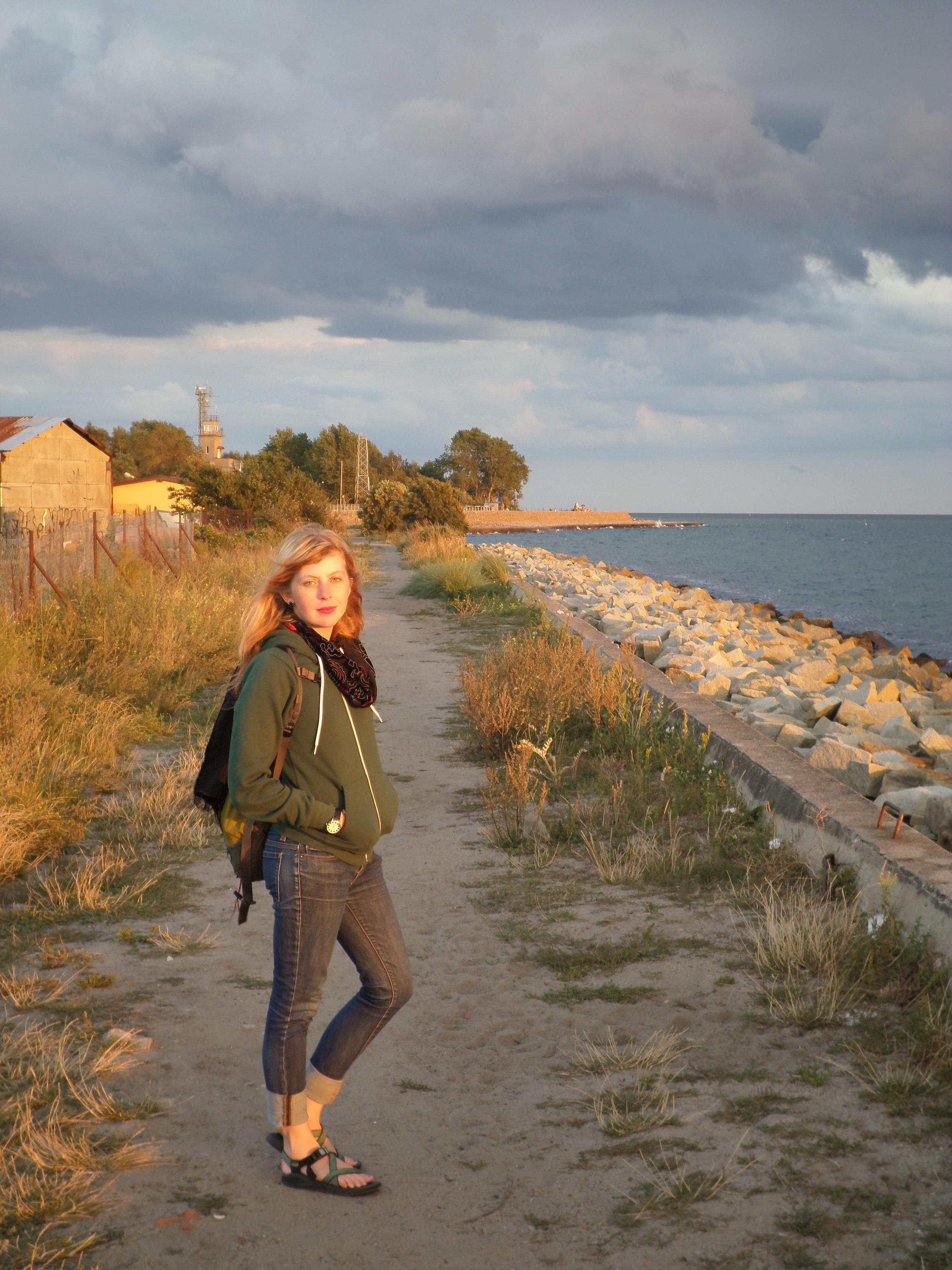 Cynthia enjoying the last rays of light in Hel, Poland