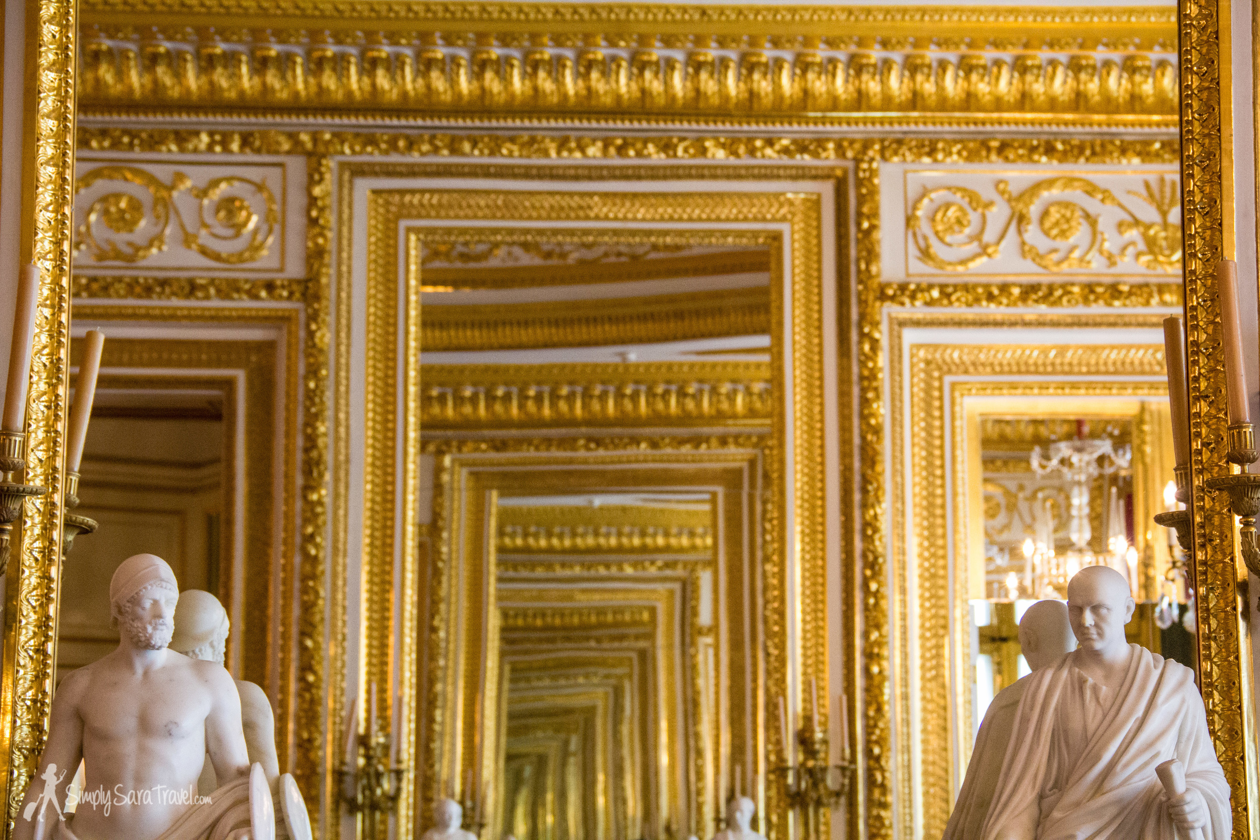 Gold mirrors and statues in the Royal Castle, Warsaw, Poland