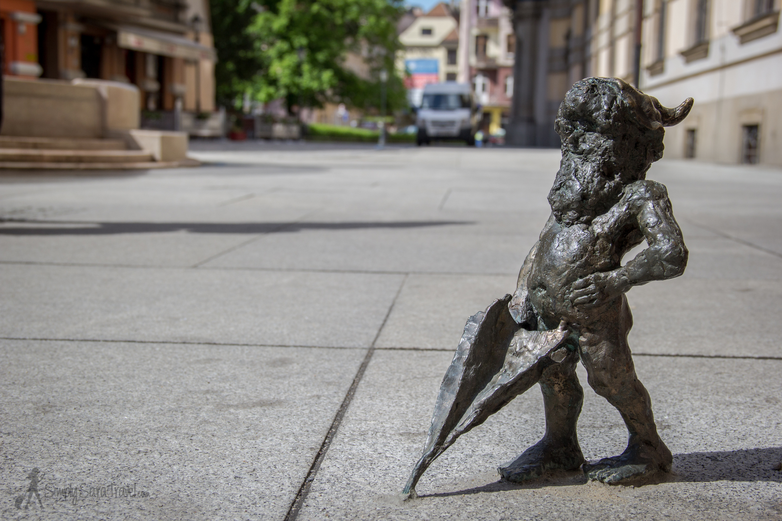 Gnome on street holding umbrella in Wroclaw, Poland