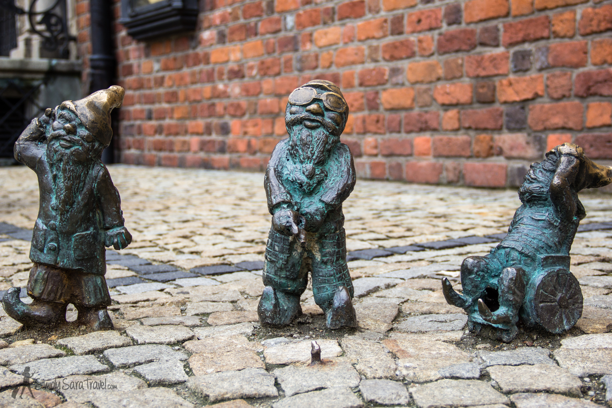 Three gnomes by Town Hall in Wroclaw, Poland