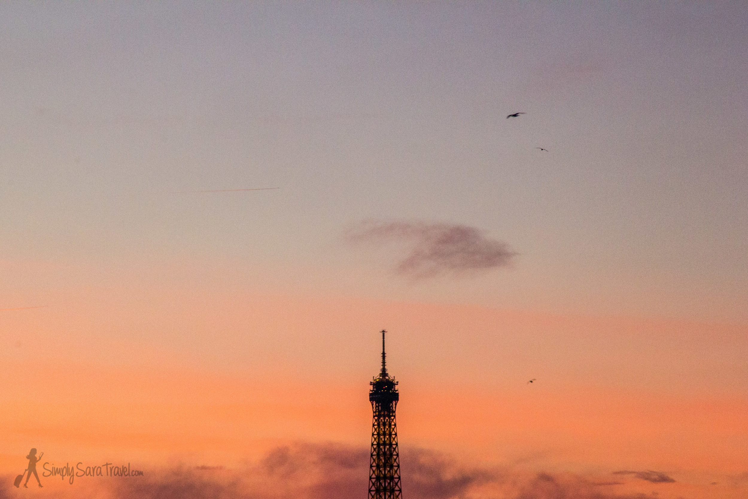 Sunset and the tip pf the Eiffel Tower, Paris, France