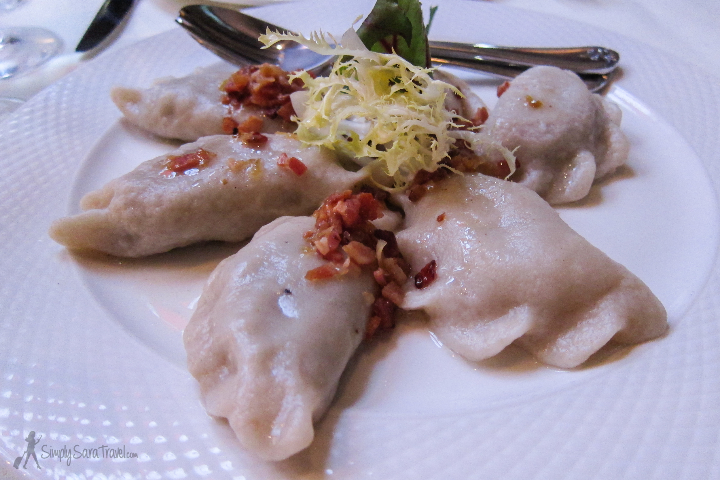 "Best of both worlds - in Poland, we found that you could live like a king, dining at great restaurants at a fraction of the price we're accustomed to. These pierogi are from our ""fancy"" meal in Gdańsk."
