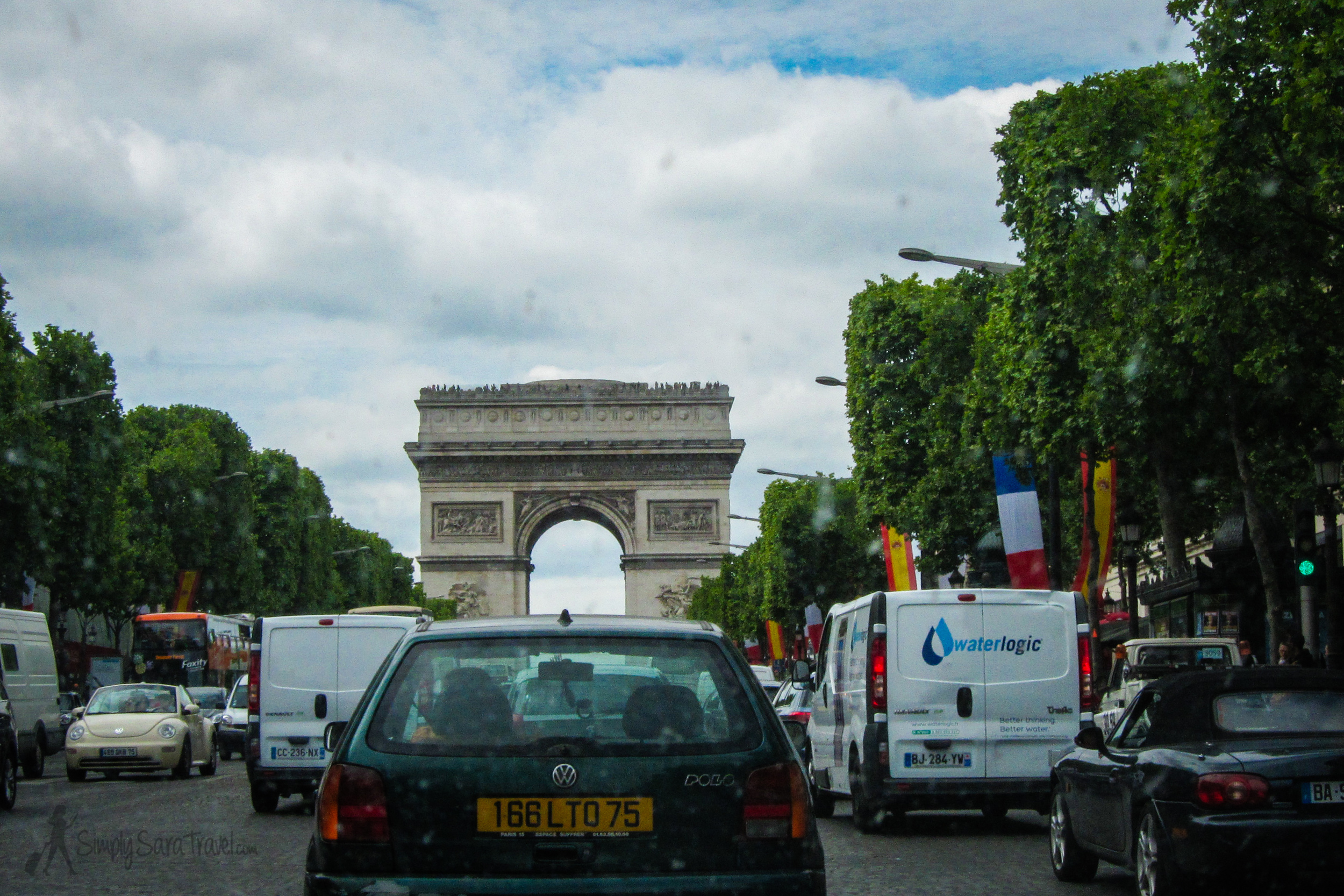 The only thing that stood in between us and returning our rental car was the Arc de Triomphe...and a very dirty windshield.