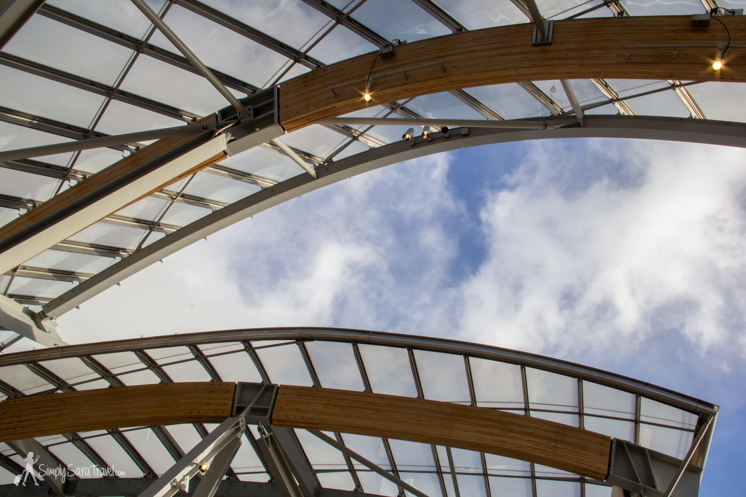 Terrace of Fondation Louis Vuitton and blue skies with clouds in Paris, France