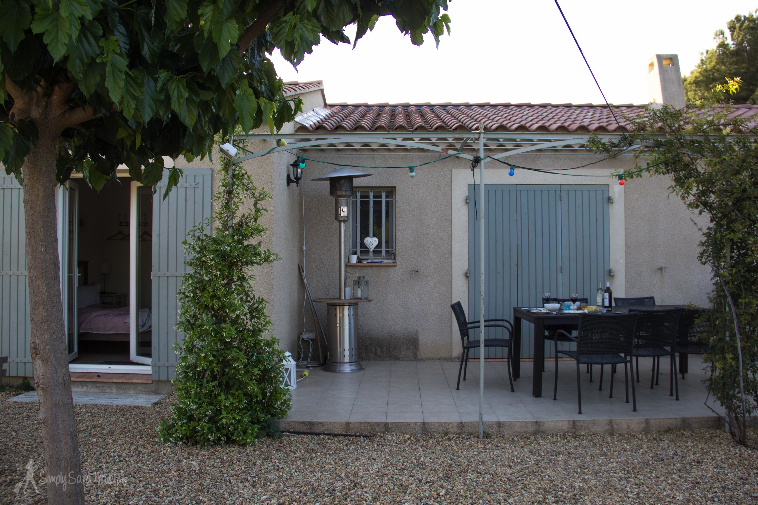The backyard of our Airbnb in Saint-Rémy-de-Provence, with the entrance to our room through the doors on the left