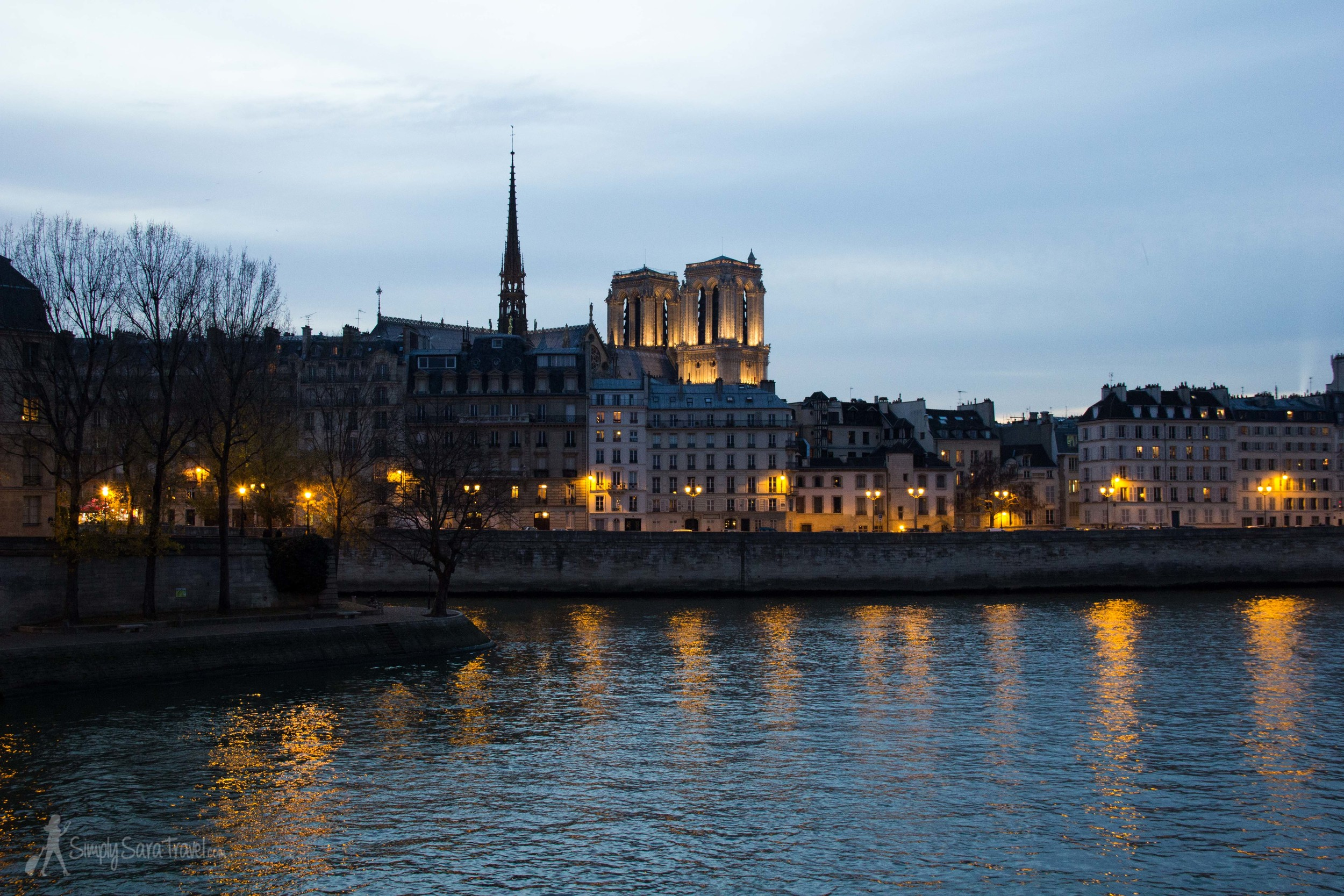 Winter twilight by the Seine in Paris with Notre Dame, France