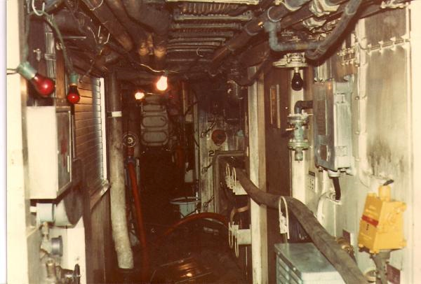 2E canteen flat Facing for'd, NAAFI shutters on the port, Petty Officers Mess Lounge starboard, with the access hatch to 3Ea Messdeck further forward.