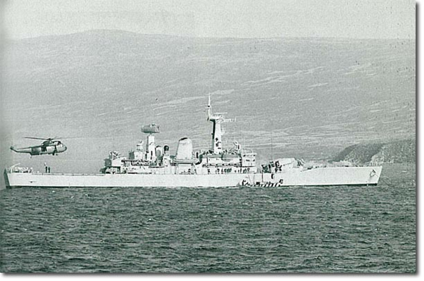 This picture shows Argonaut anchored at San Carlos after the big hit. A Sea King is bringing-in damage control equipment and the Royal Marines landing craft is delivering, I think, more welding equipment - helicopters don't like carrying compressed gas.