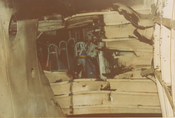 Ship's side (Right) with entry hole. Viewed from within the fuel tank looking aft through the entry route into the magazine.