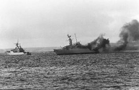 Ardent, seriously damaged after being struck by several bombs, started to recover but was struck again. We could only watch helplessly whilst HMS Yarmouth went to her aid (pictured).