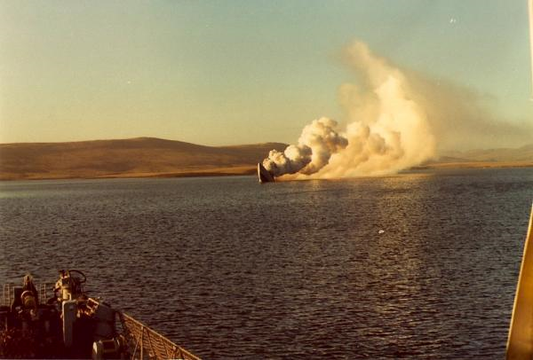 HMS Antelope's bows-up, before the final plunge - viewed from HMS Argonaut.