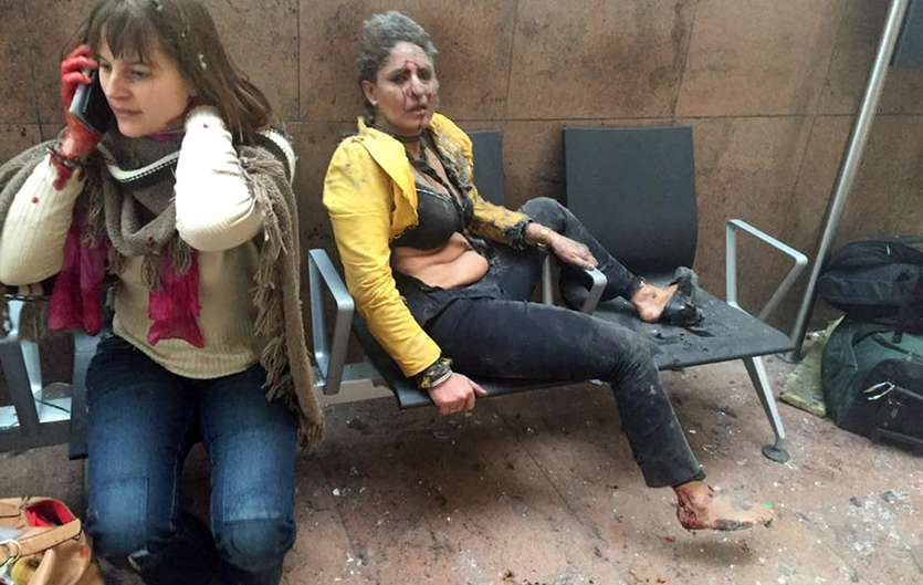1 x injured. 1x cretin on her phone. 1 x cretin taking a photograph.