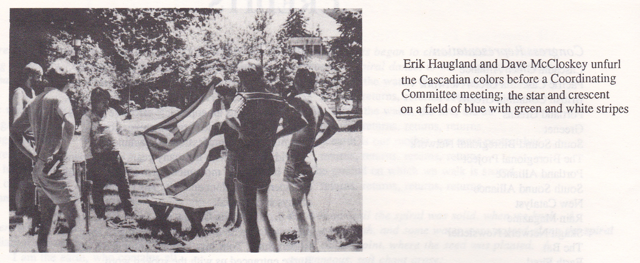 Erik Haugland and Dave McCloskey unfurl the Cascadian colors before a Coordinating Committee meeting; the star and crescent on a field of blue with green and white stripes