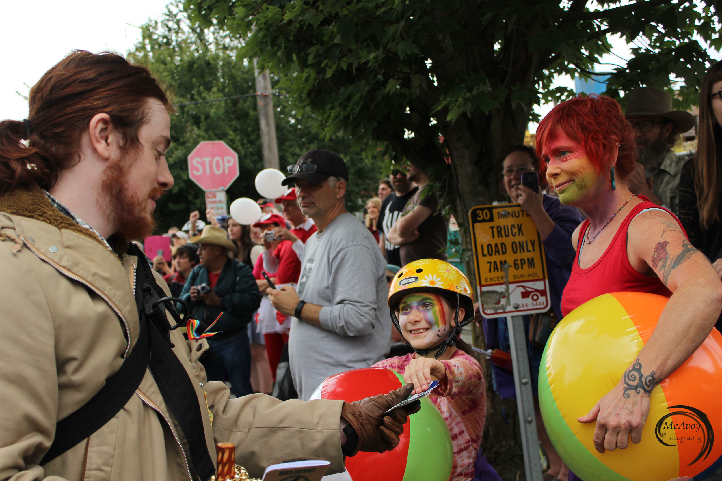 CascadiaNow! Communications Officer Tanner Colvin dressed up as a Sasquatch denier searching for the mythical creature. Colvin and other parade ensemble members interacted with parade viewers and handed out Cascadia flag stickers.