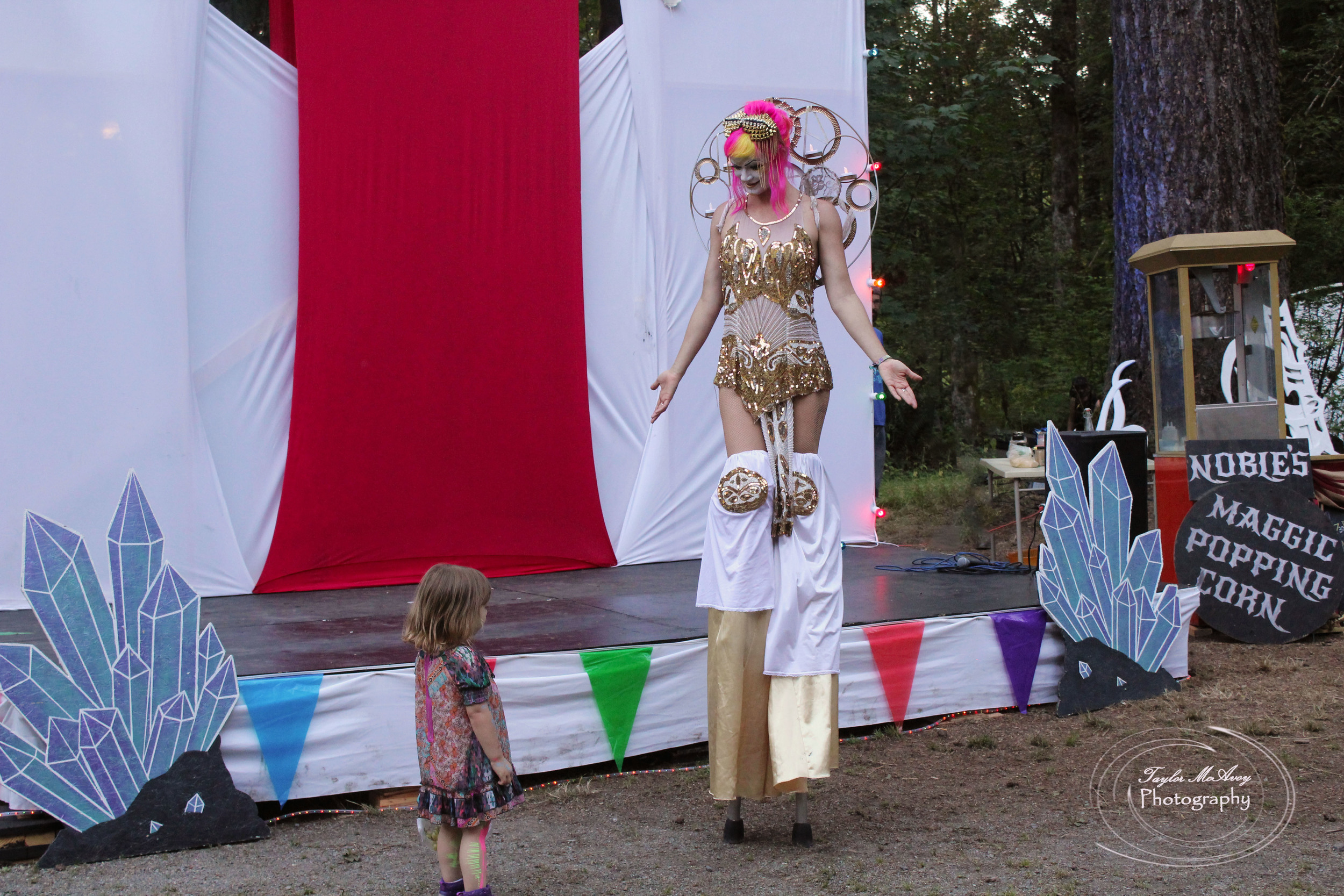 Performer Gale Force dressed in her best attire for the closing ceremonies, enchanting and stealing the heart of a young girl.