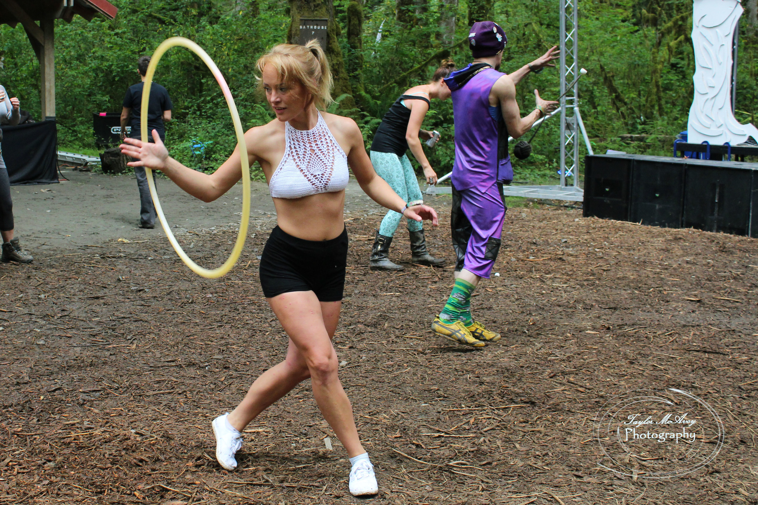 Sydnie Stemn practices hooping at the river stage.