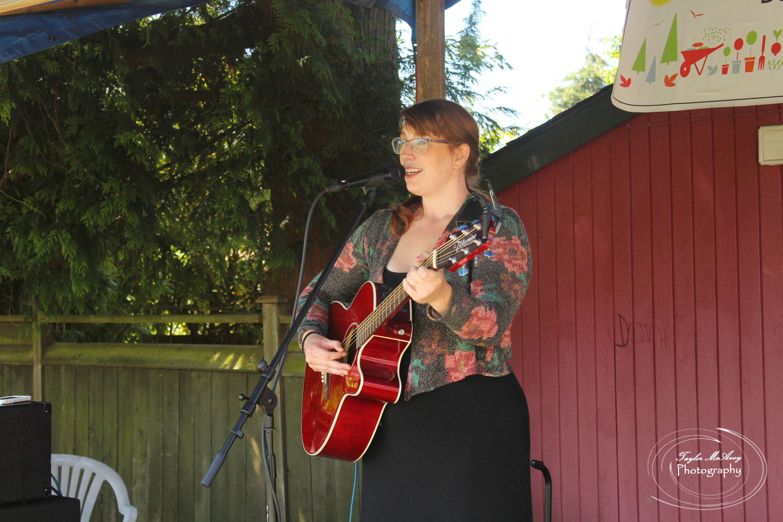 Musician Megan Larson fills the garden with music for all to enjoy.