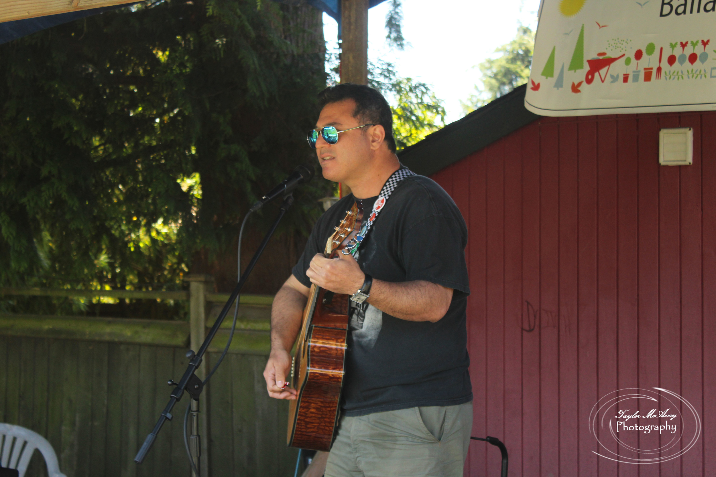 Musician Ben Henry performed at a small stage set in the gardens for community members to sit and enjoy or listen to while exploring.