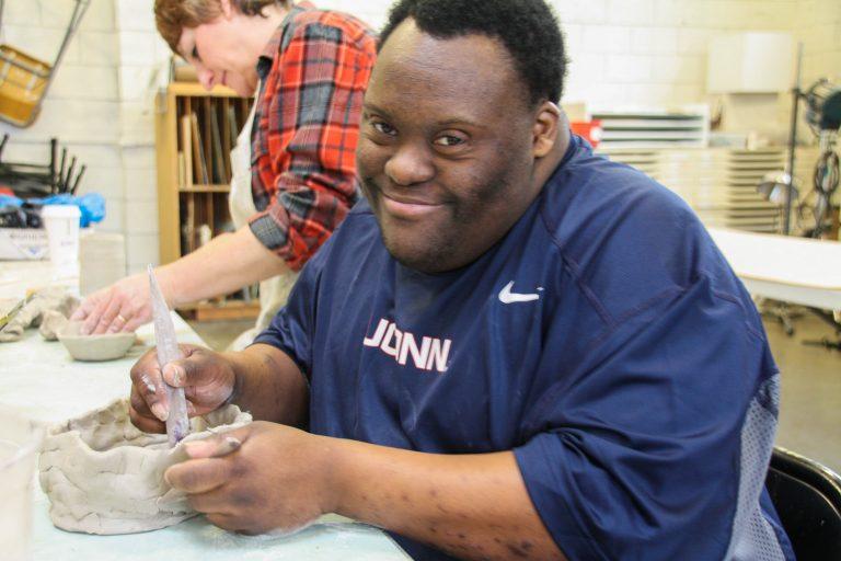 VPAC artist Joey Joeseph works on a ceramic piece.