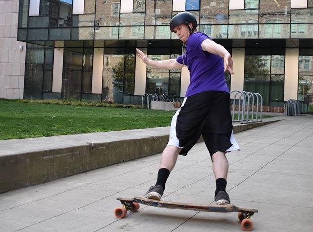 mikey longboarding outside moles building.jpg