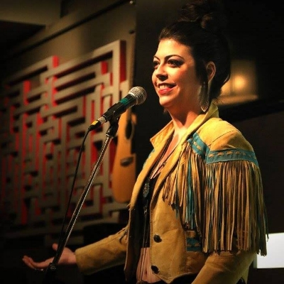 Cobra Collins is a Calgary based Metis poet of significant height. She was the captain and coach of Calgary's 2016 Slam team, representing our city on a national level at the Canadian Festival of Spoken Word and is a member of Calgary's Inkspot Spoken Word Collective, home of Calgary's official poetry Slam.Cobra has participated in several Nationwide Spoken Word festivals, as well as collaborated with artists of different backgrounds for dance (Fluid Movements Arts Festival) and performance festivals (IKG 1 ! Live Performance Festival). Cobra was also honoured to be shortlisted as a nominee for Calgary's 2017 poet laureate.