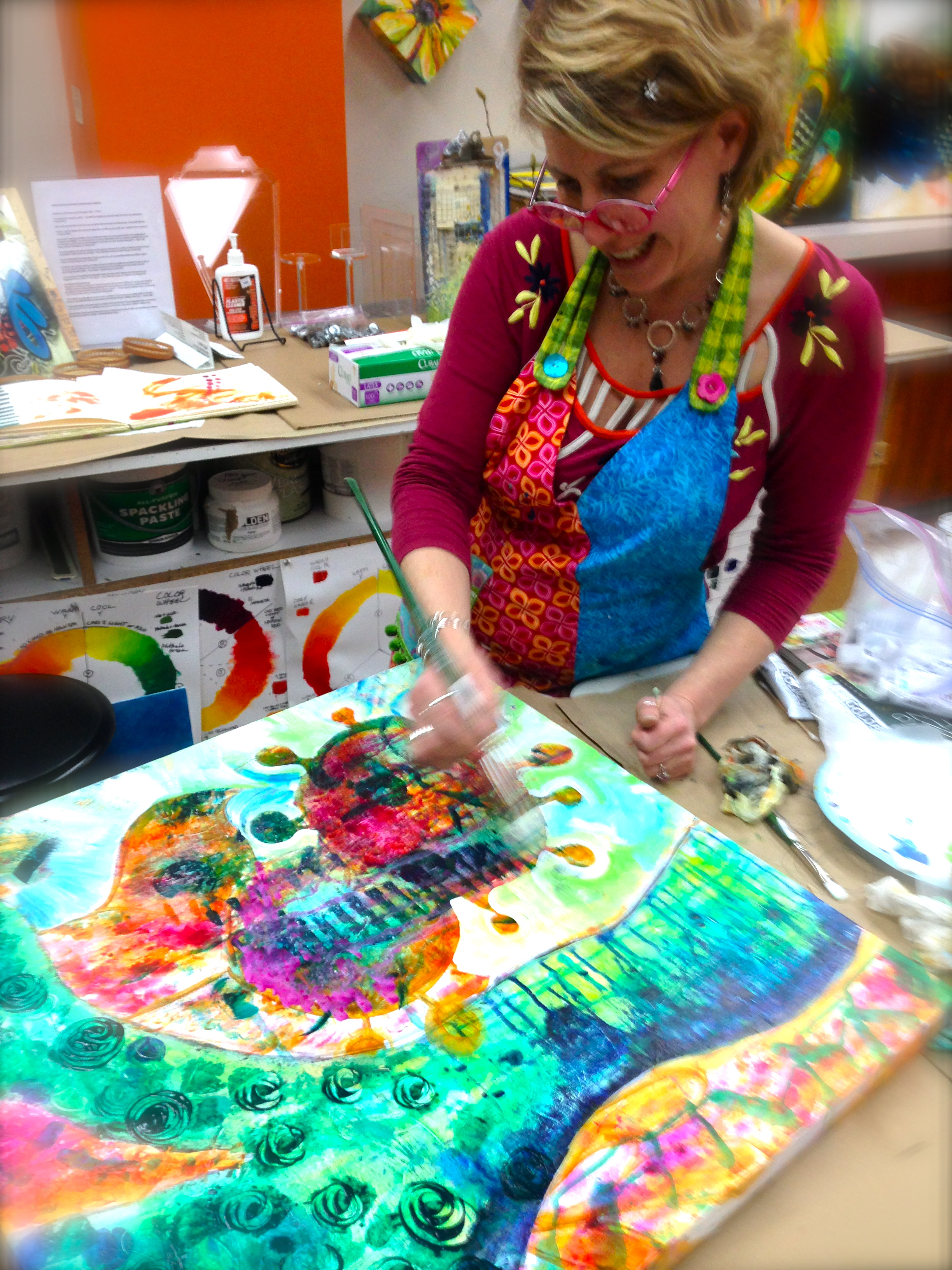 Sam painting an abstract self portrait at the ARTspot Studio.