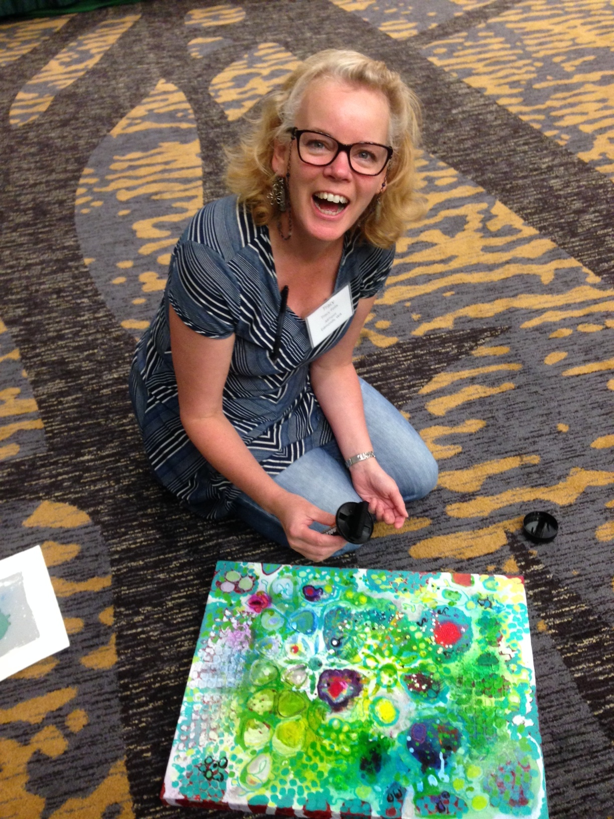 ARTspot owner Tracy Felix getting ready to paint over her favorite painting so far. Images of her first 10 paint-overs at top of page.Just do it!