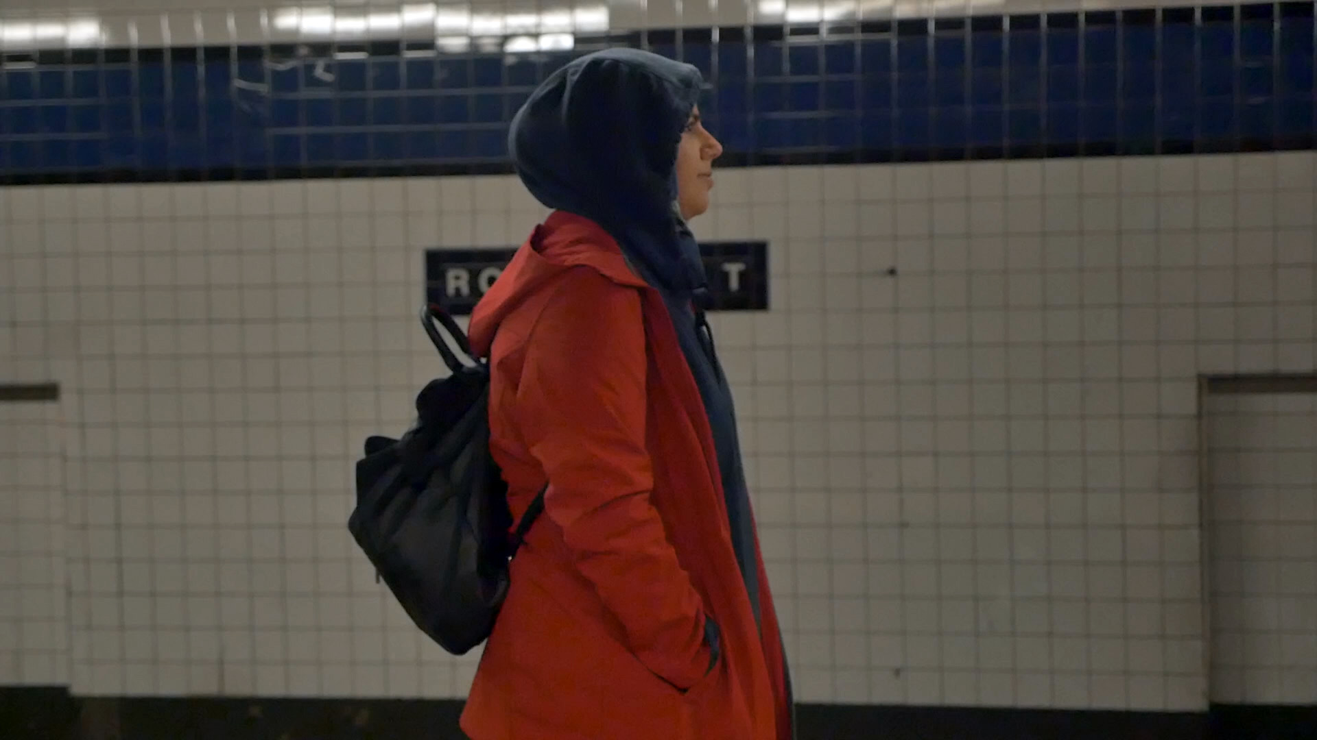 Badiaa, a radiology student,waits for the 5:14 a.m. train to her job at Dunkin Donuts.