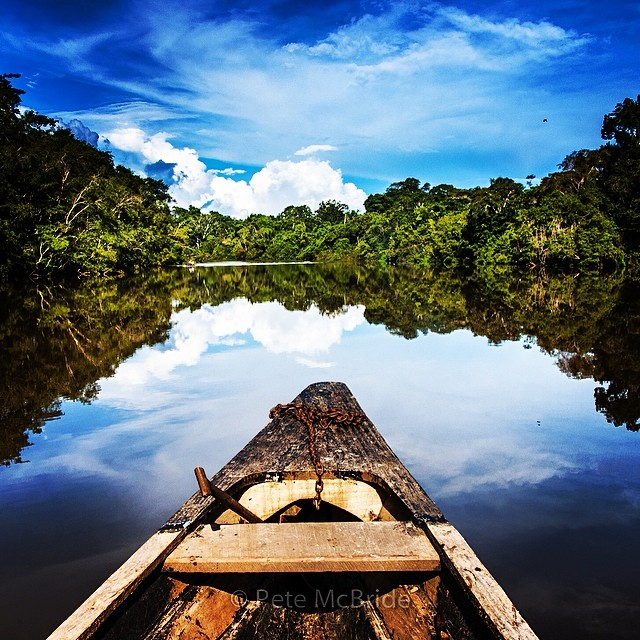 Photo__pedromcbride._A_dugout_canoe_on_a_calm__Amazon_River__snaking_through_Peru_on_its_4000_mile_march_to_the_Atlantic___one_of_my_most_memorable_journeys_with_the_late_writer_Matt_Power__a_regular_contributor_to__natgeo__adventure._Matt_tragically.jpg