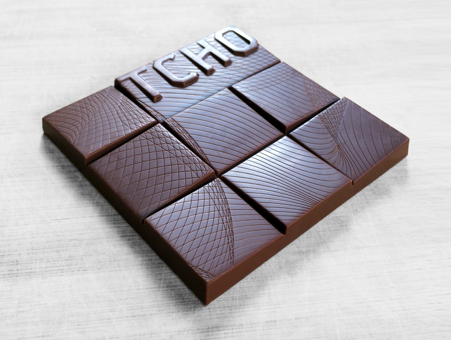 TCHO's new inclusion chocolate bar design. By strategically elevating portions of the existing bar grid, Andrea and I created the new 'erupted' mold design. Designed and collaborated with  Andrea Faucett  .