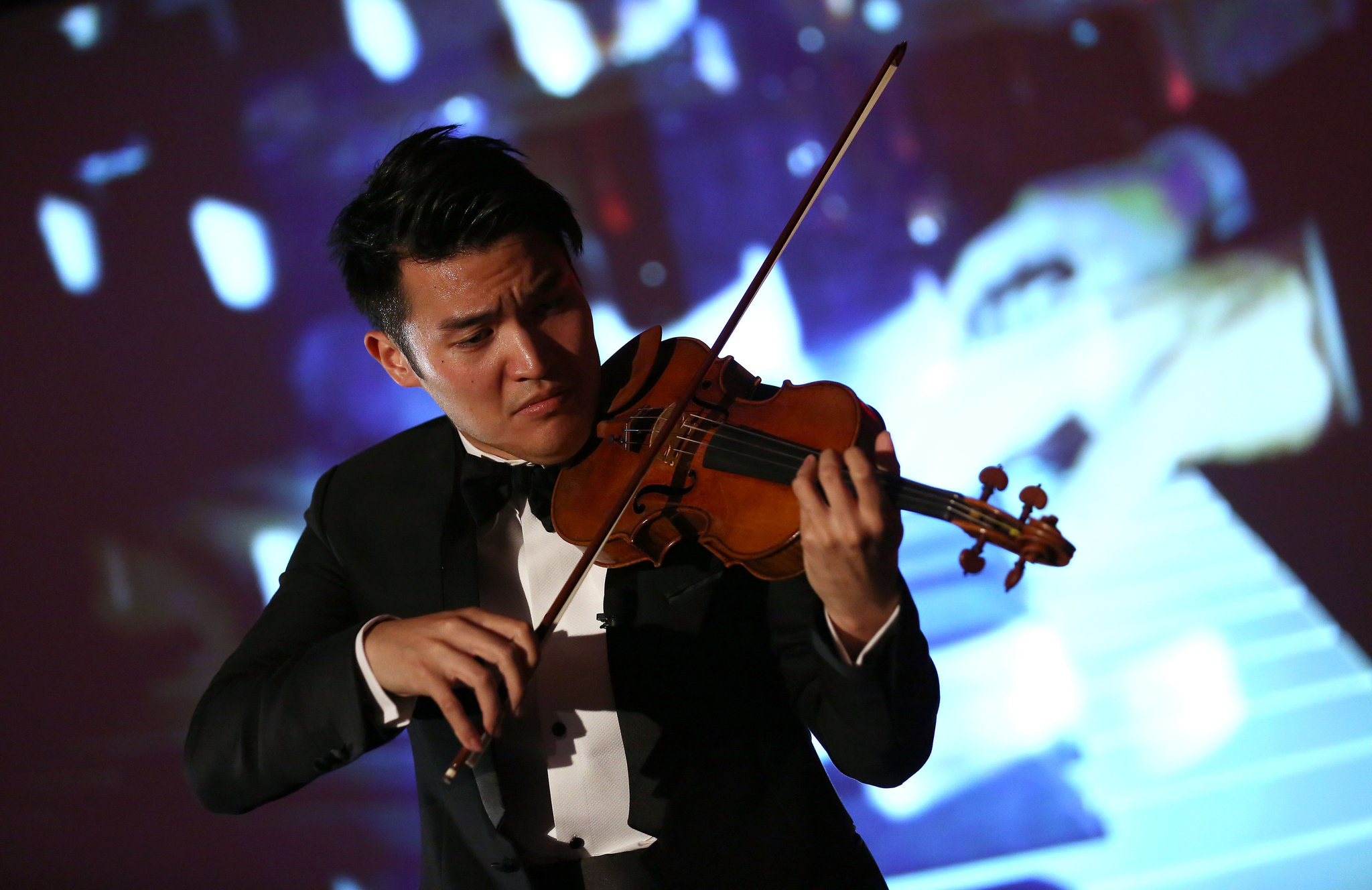 Ray Chen performing with the Israel Philharmonic Orchestra in London in 2014. The award-winning violinist is using social media to help build a younger audience for classical music.